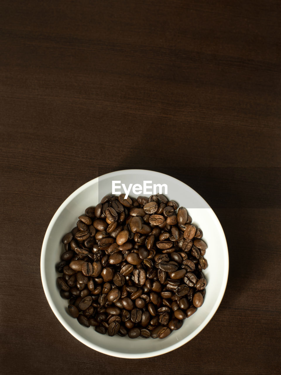food and drink, food, indoors, roasted coffee bean, still life, coffee - drink, brown, directly above, freshness, coffee, table, large group of objects, no people, coffee bean, studio shot, abundance, close-up, wood - material, raw food, bowl, caffeine, crockery, breakfast