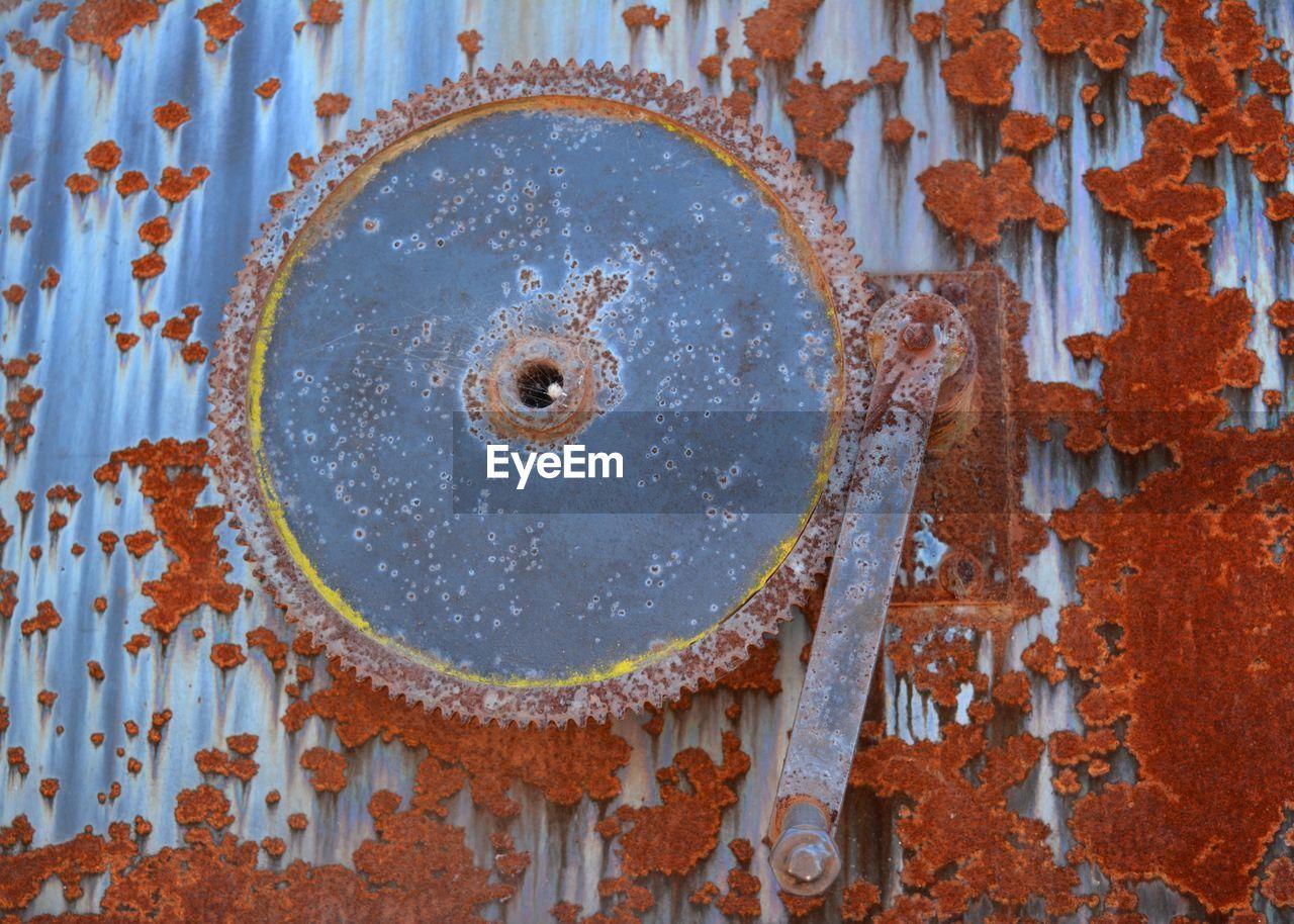 Close-Up Of Rusty Circular Saw On Wall