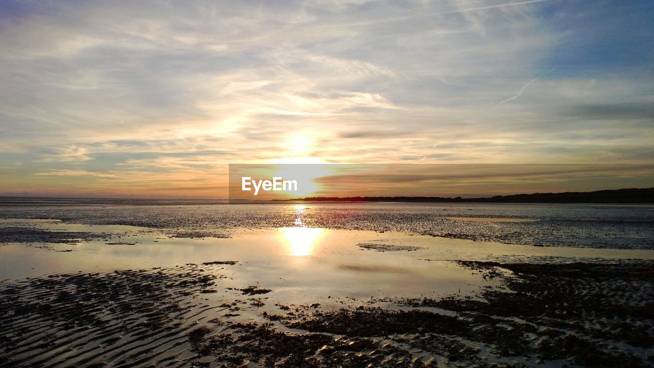 sky, sunset, water, scenics - nature, beauty in nature, tranquil scene, cloud - sky, tranquility, sea, reflection, land, beach, idyllic, nature, no people, horizon, horizon over water, sun, sunlight, outdoors