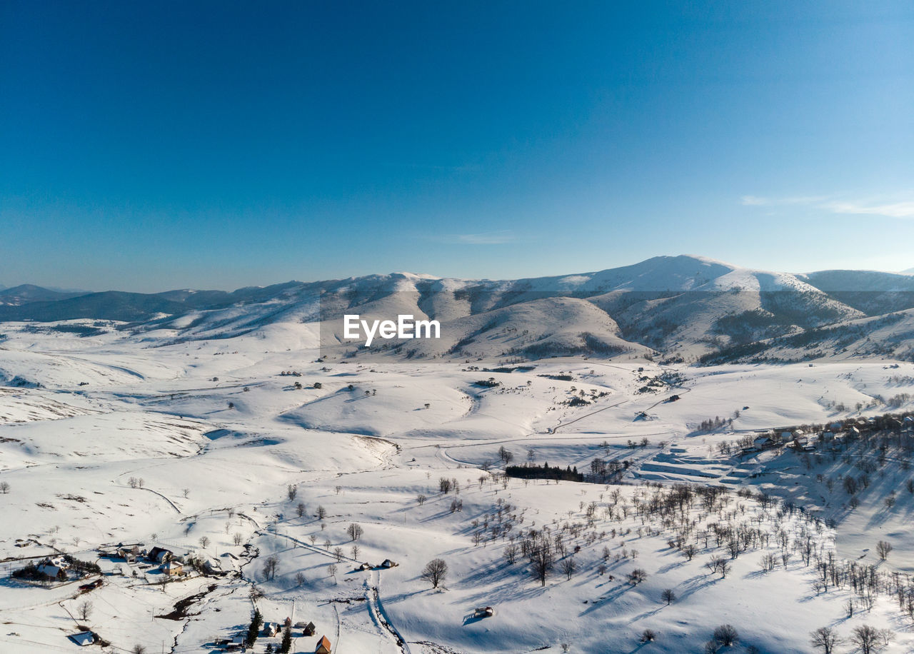 cold temperature, winter, mountain, sky, scenics - nature, beauty in nature, snow, tranquil scene, tranquility, mountain range, blue, non-urban scene, environment, nature, white color, idyllic, day, landscape, clear sky, no people, snowcapped mountain, mountain peak