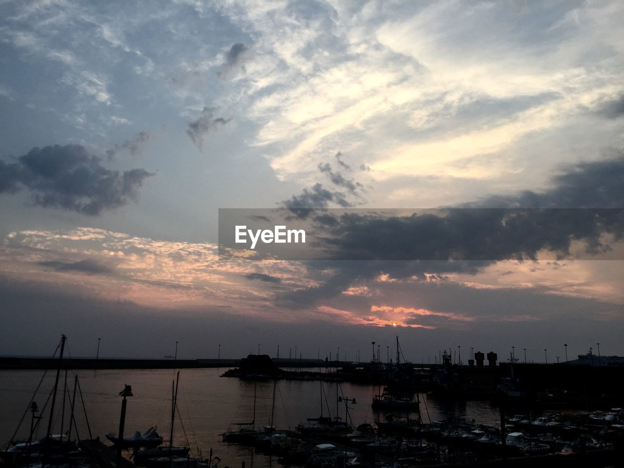 sunset, sky, cloud - sky, nautical vessel, silhouette, water, sea, no people, harbor, built structure, beauty in nature, building exterior, nature, scenics, outdoors, architecture, sailboat, moored, travel destinations, mast, city, horizon over water, yacht, cityscape, day