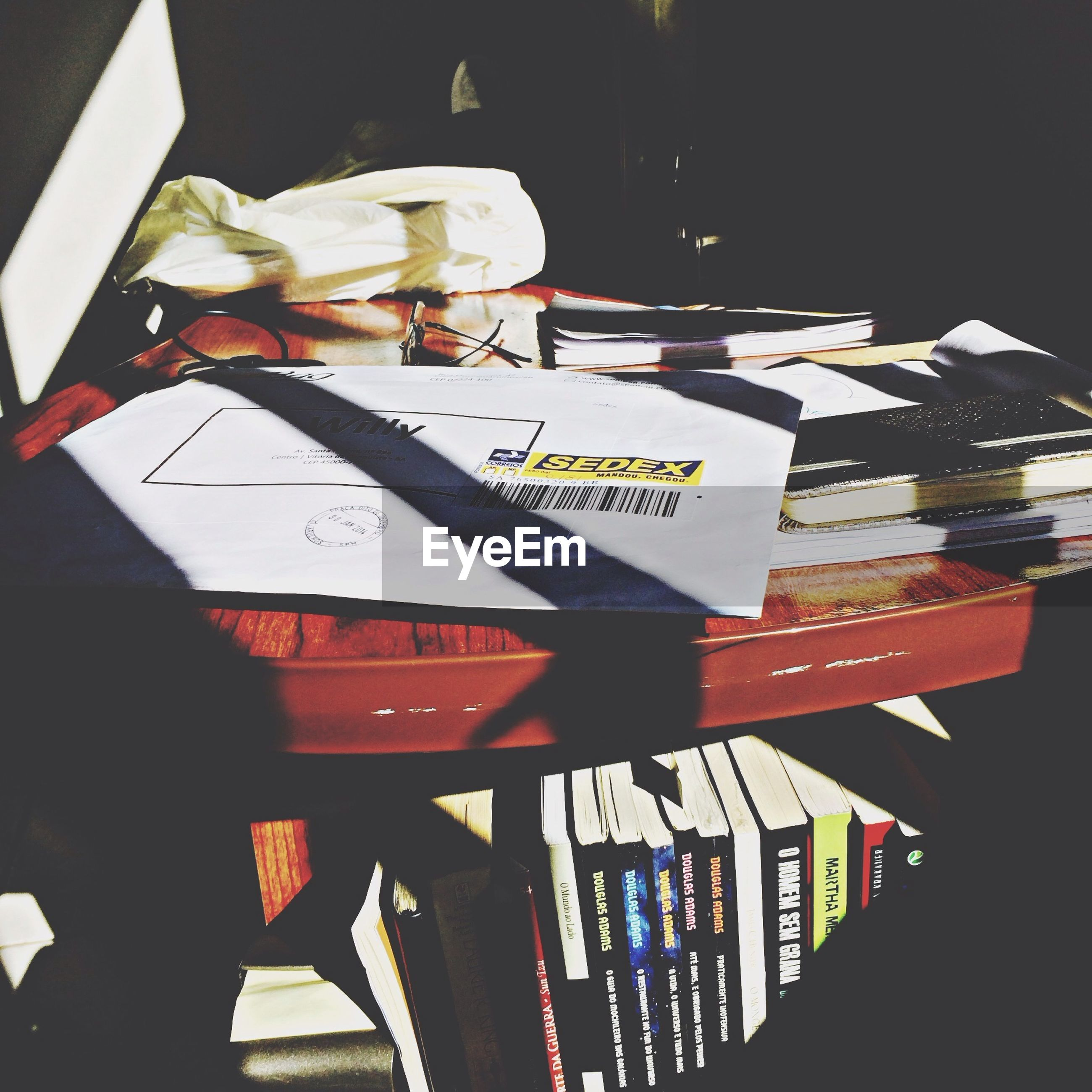 indoors, text, table, paper, still life, book, western script, variation, communication, close-up, high angle view, no people, night, wood - material, freshness, home interior, non-western script, choice, education, arrangement