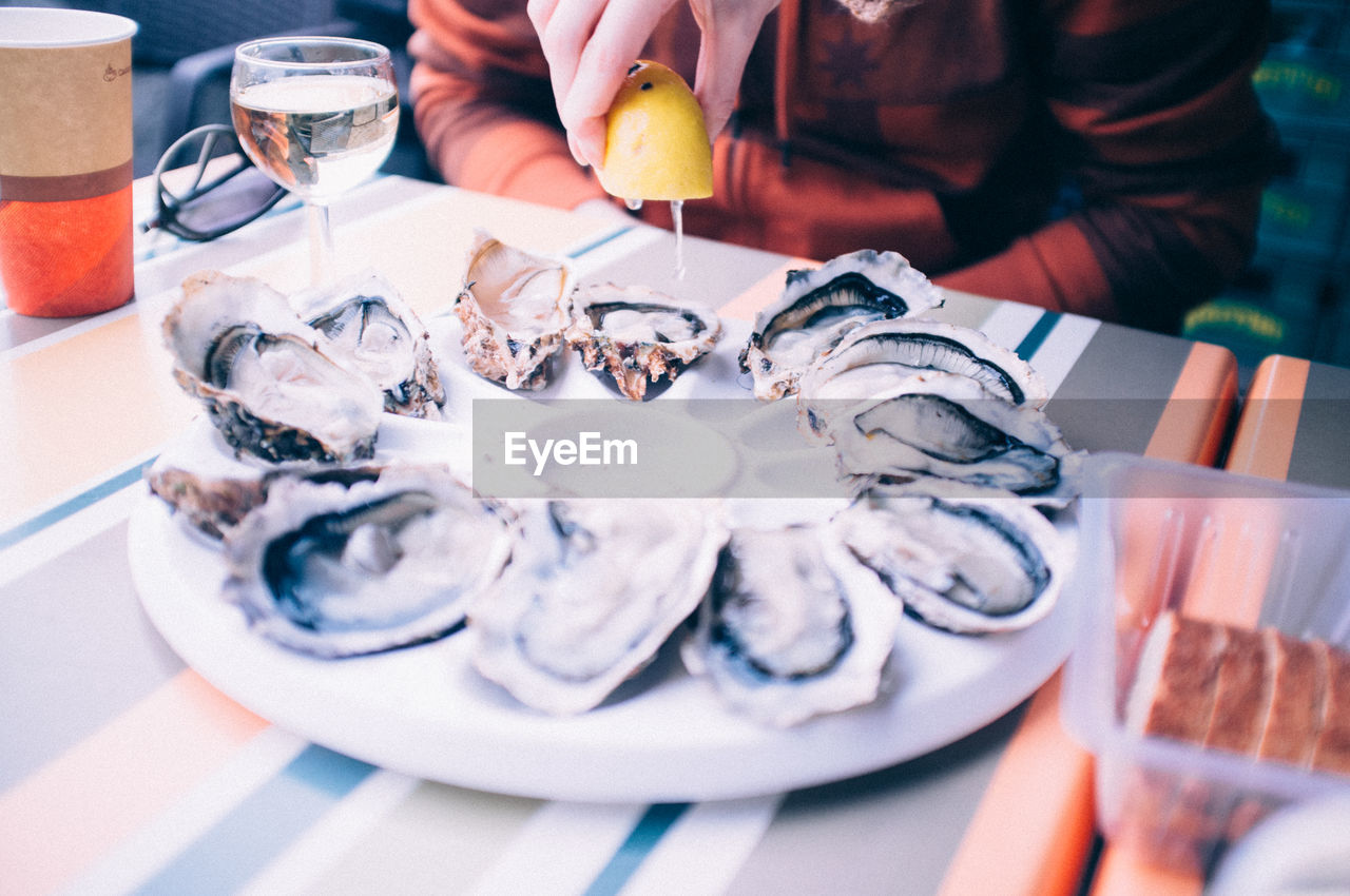 Oyster served with white wine in a restaurant