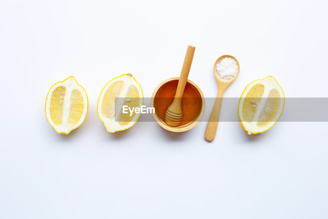 white background, studio shot, citrus fruit, still life, food, food and drink, fruit, indoors, healthy eating, copy space, freshness, no people, wellbeing, slice, lemon, group of objects, high angle view, orange color, close-up, cross section, orange, temptation