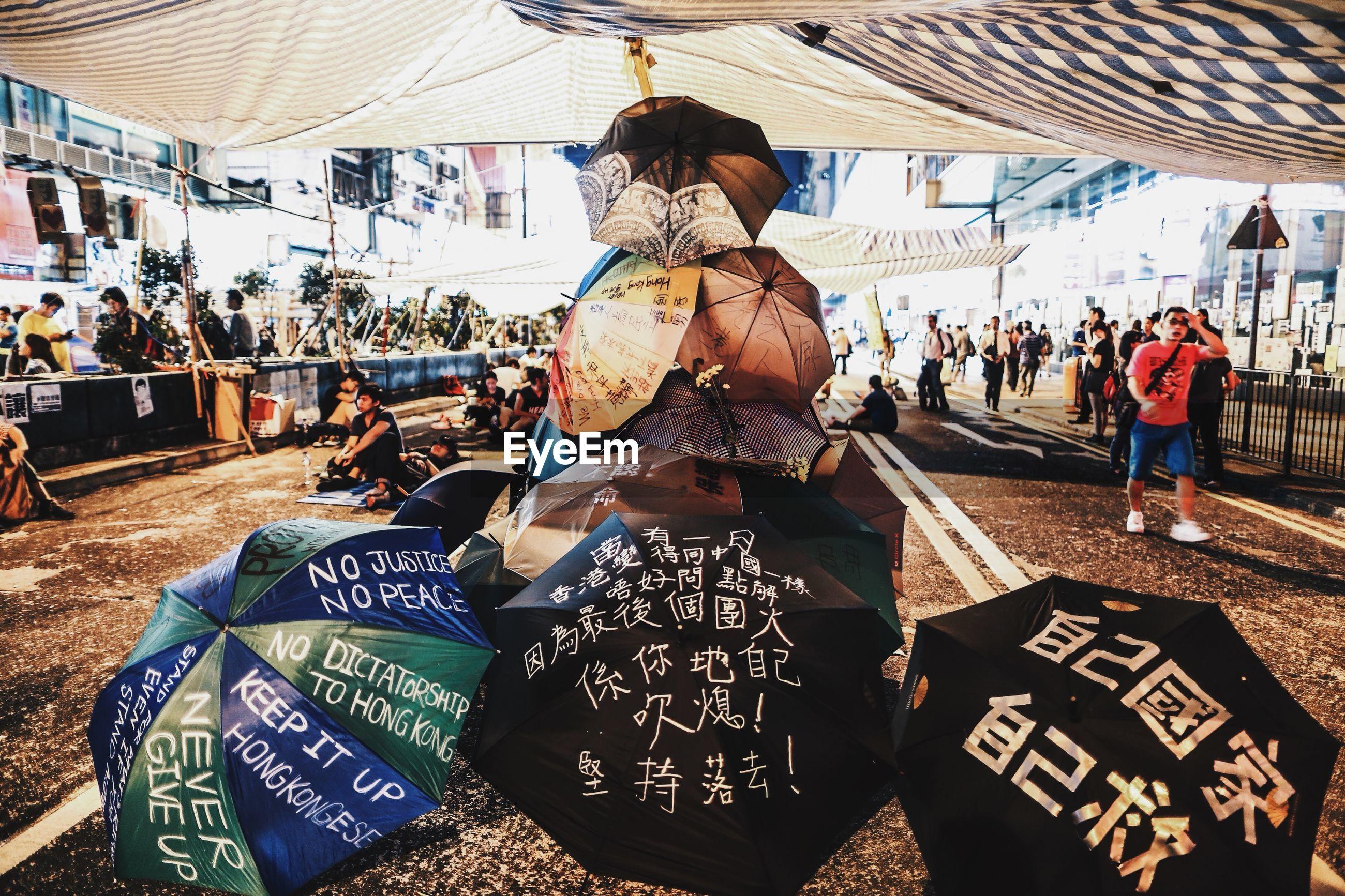People walking by creative umbrellas on display