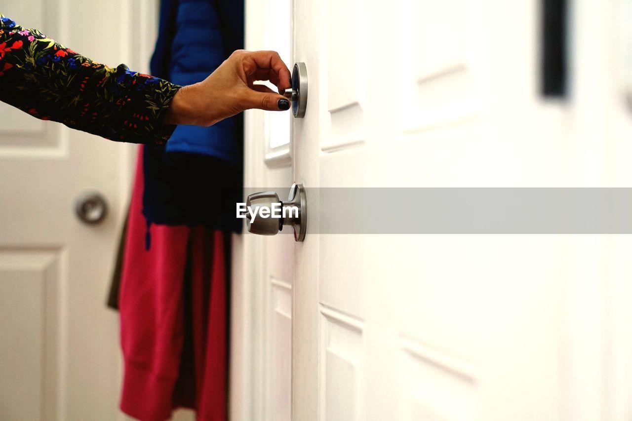 Cropped Hand Holding Door