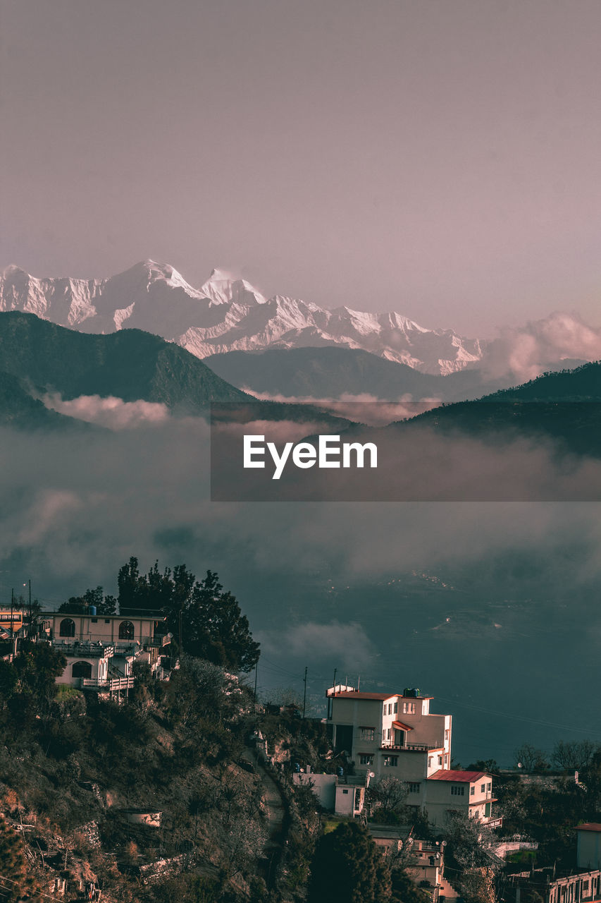 mountain, building exterior, architecture, built structure, sky, building, residential district, city, beauty in nature, nature, cloud - sky, no people, mountain range, scenics - nature, outdoors, house, environment, tree, town, high angle view, townscape
