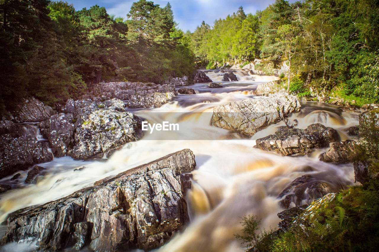 Scenic view of river amidst rock formations