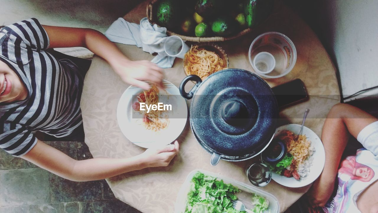 Directly above shot of women sitting at dining table