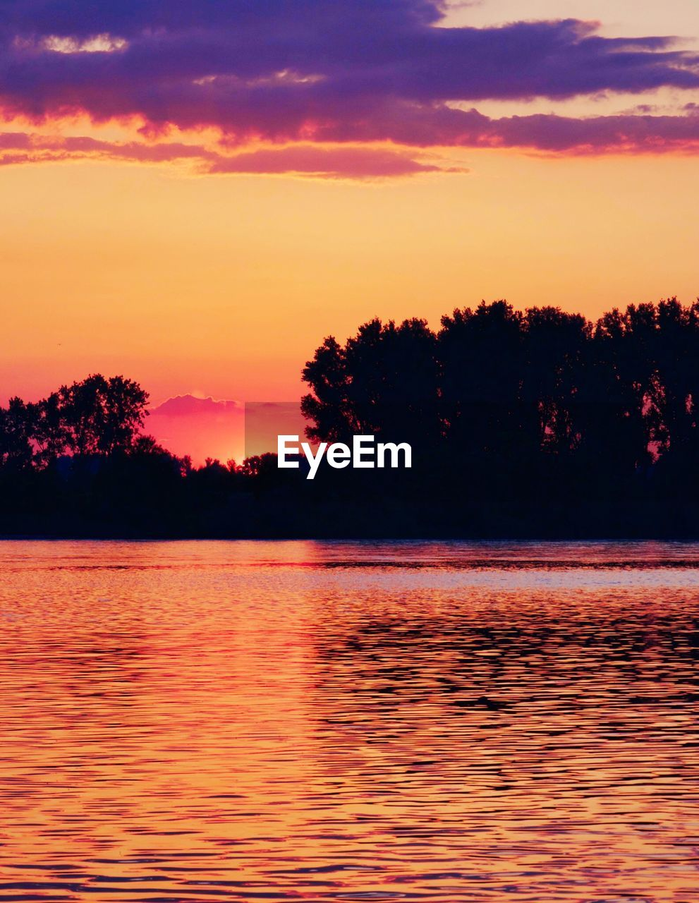sunset, sky, water, beauty in nature, scenics - nature, tree, tranquility, tranquil scene, orange color, silhouette, lake, cloud - sky, nature, plant, waterfront, idyllic, no people, reflection, non-urban scene, outdoors, romantic sky