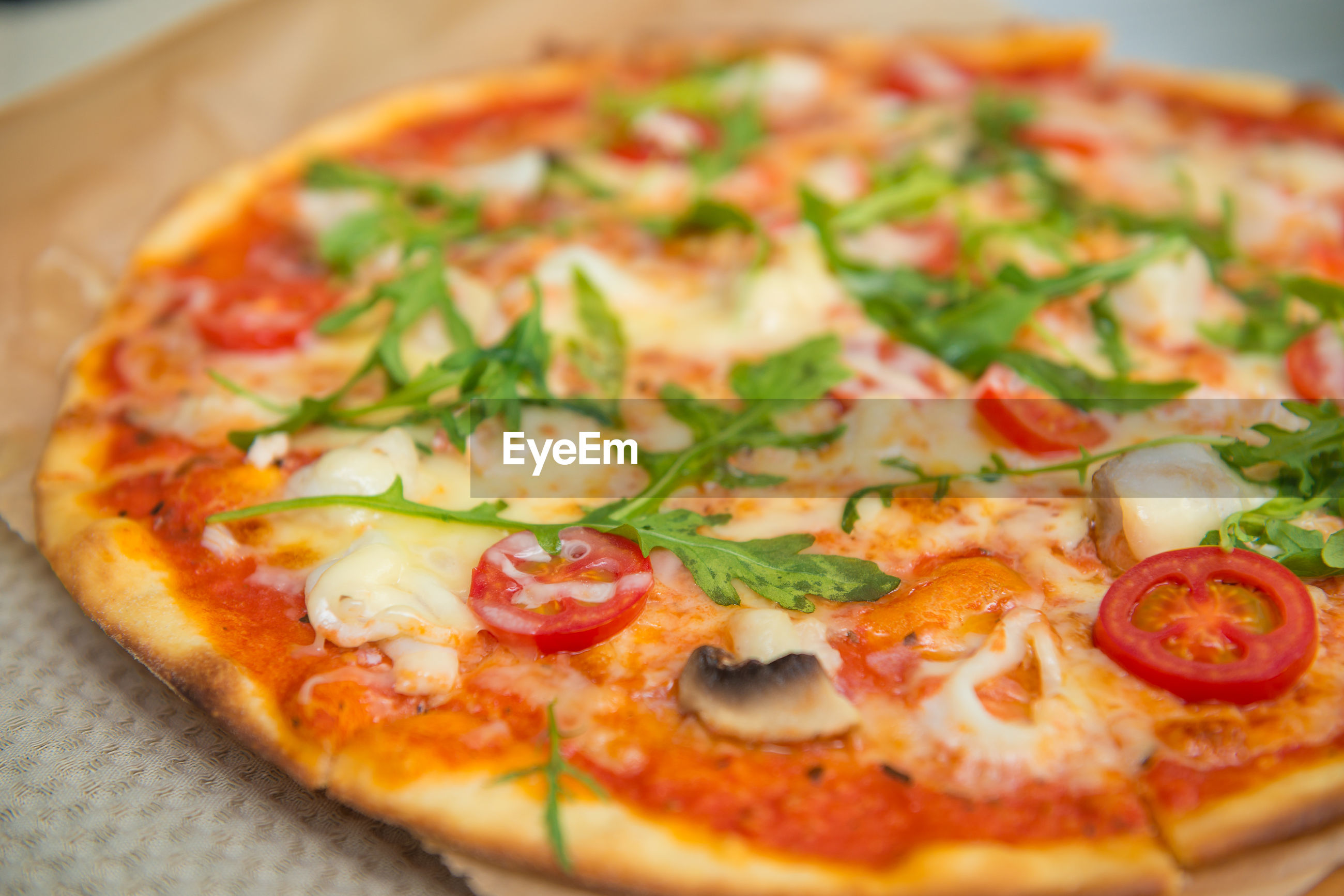 CLOSE-UP OF PIZZA SERVED ON PLATE