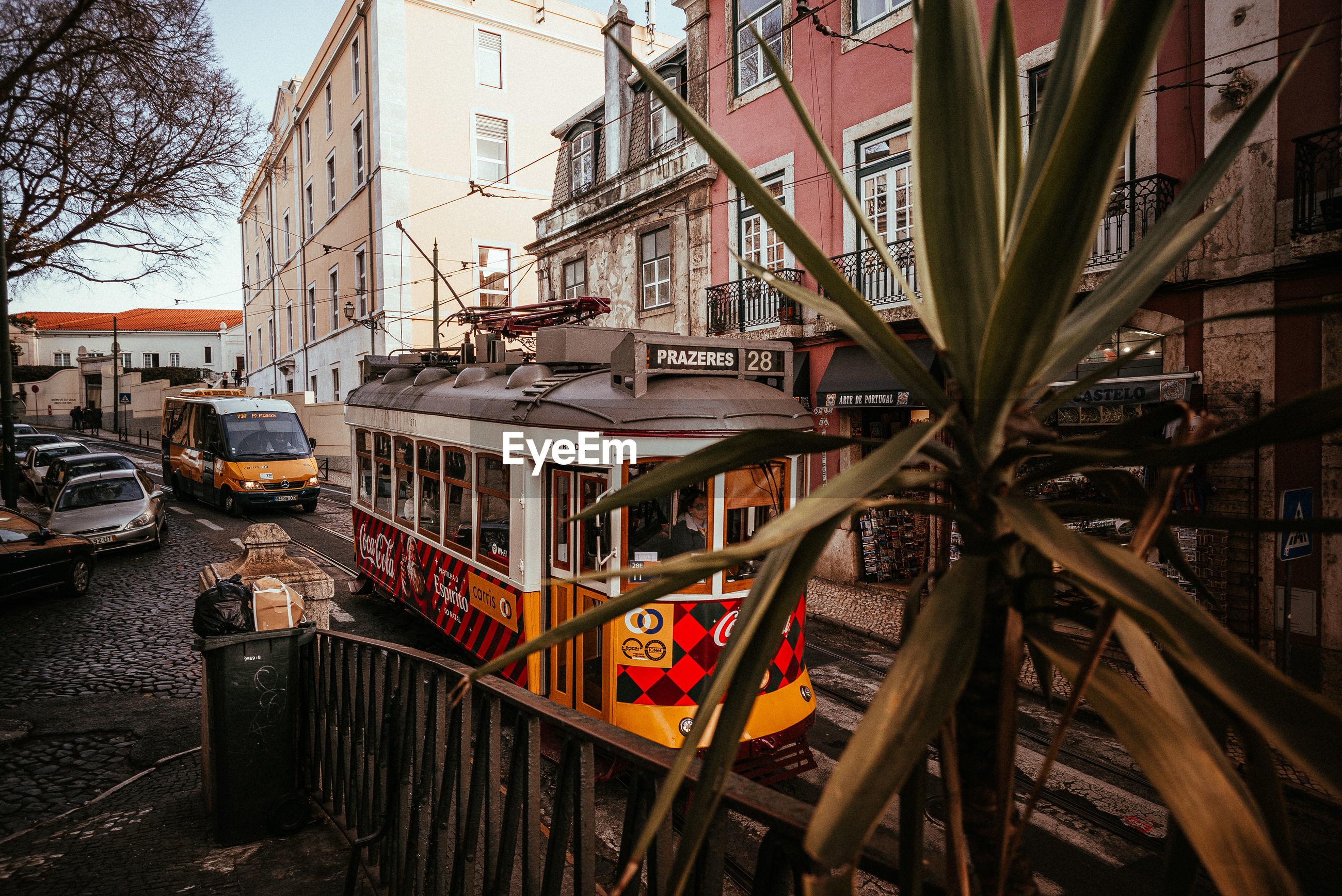 STREET BY BUILDINGS IN CITY