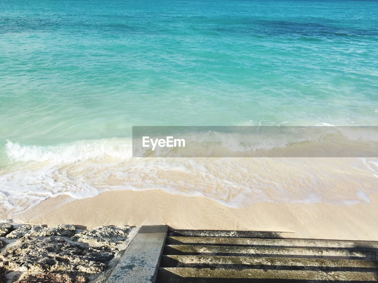water, beach, sea, land, wave, beauty in nature, tranquility, motion, nature, aquatic sport, scenics - nature, sport, no people, tranquil scene, day, sand, idyllic, outdoors, power in nature, turquoise colored