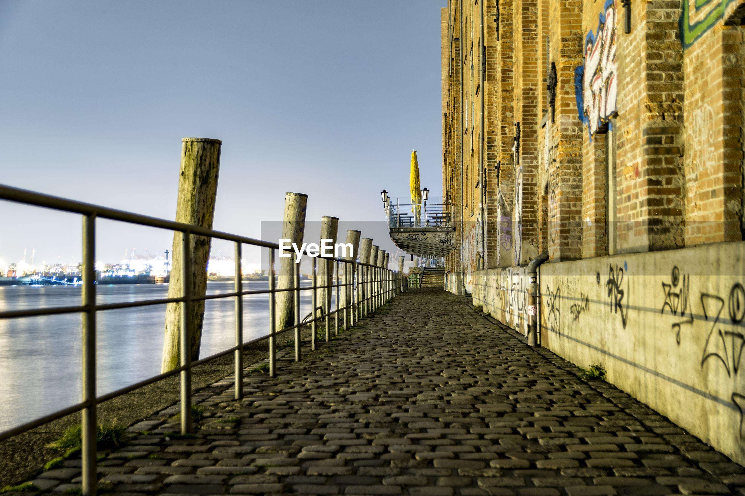 SIDEWALK BY CITY AGAINST CLEAR SKY