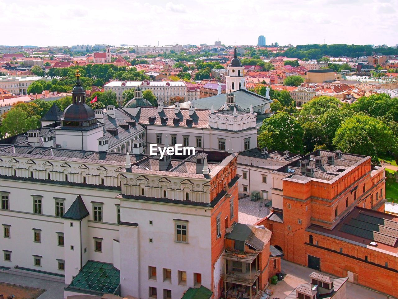building exterior, architecture, built structure, city, building, roof, high angle view, residential district, cityscape, crowded, crowd, day, nature, sky, town, tree, house, community, townscape, outdoors, settlement