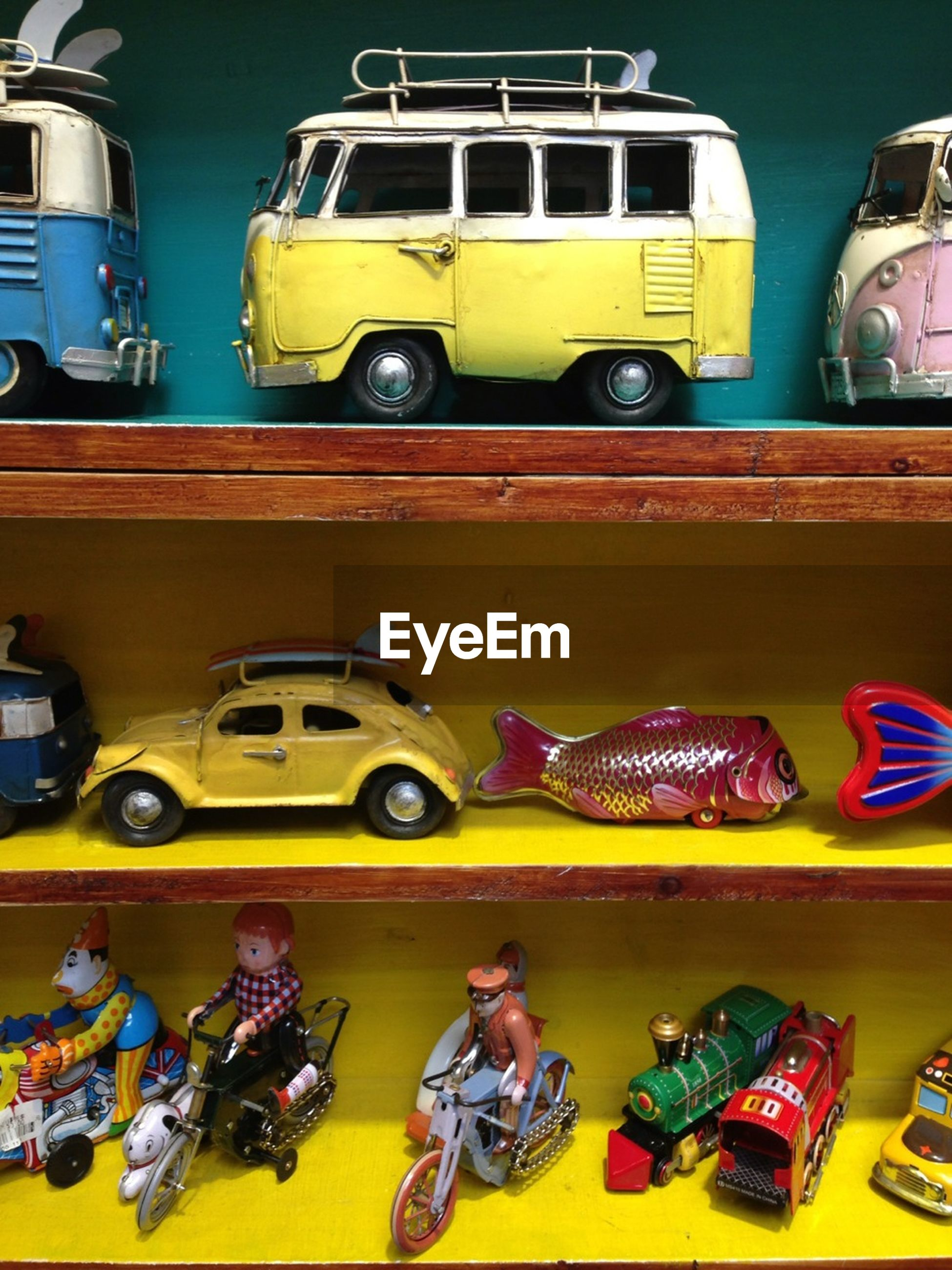 land vehicle, transportation, mode of transport, yellow, car, variation, multi colored, stationary, large group of objects, in a row, side by side, no people, outdoors, choice, store, day, abundance, toy, retail, parking