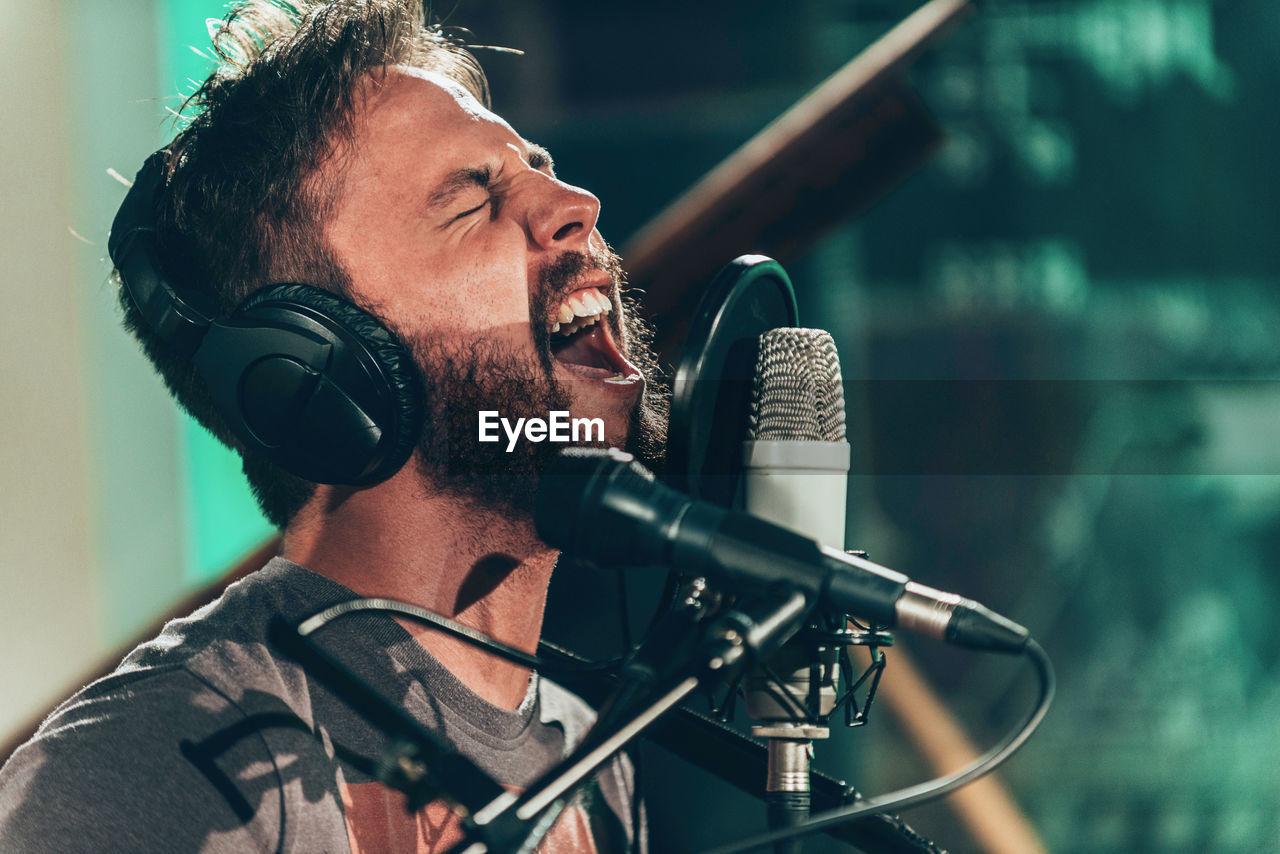 Close-Up Of Young Man Singing