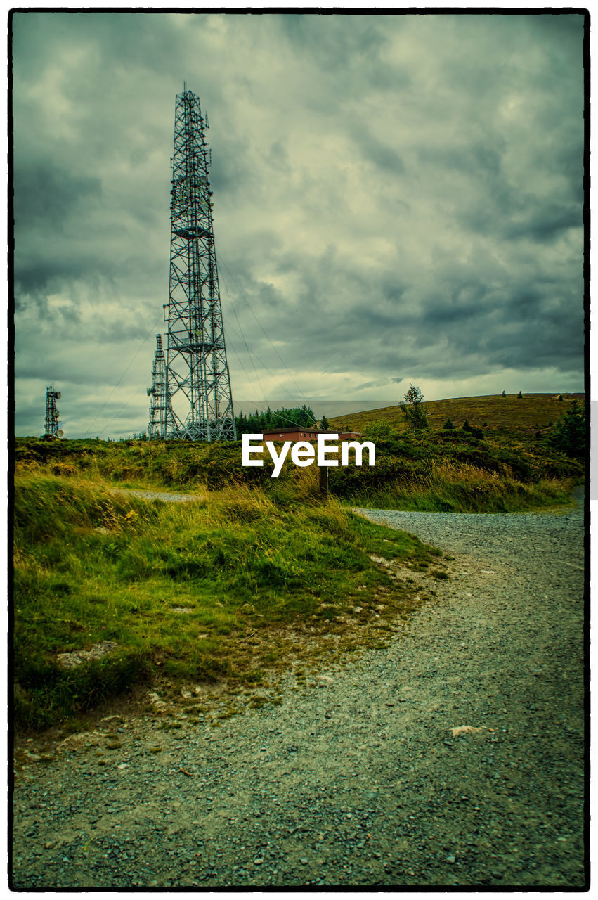grass, landscape, cloud - sky, sky, field, no people, tranquil scene, tower, electricity pylon, day, tranquility, tree, nature, outdoors, electricity, scenics, rural scene, growth