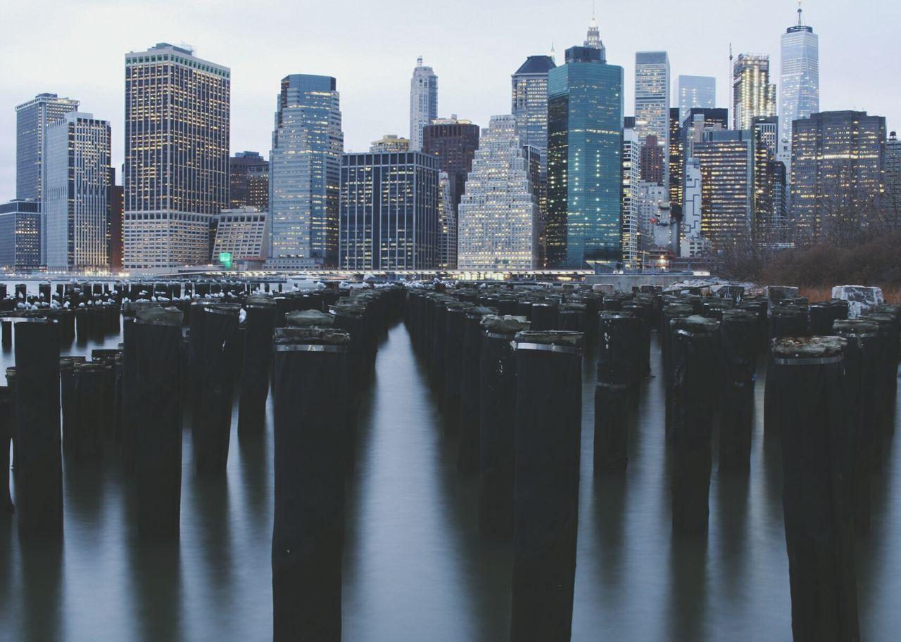 Panoramic Shot Of Illuminated Cityscape Against Sky