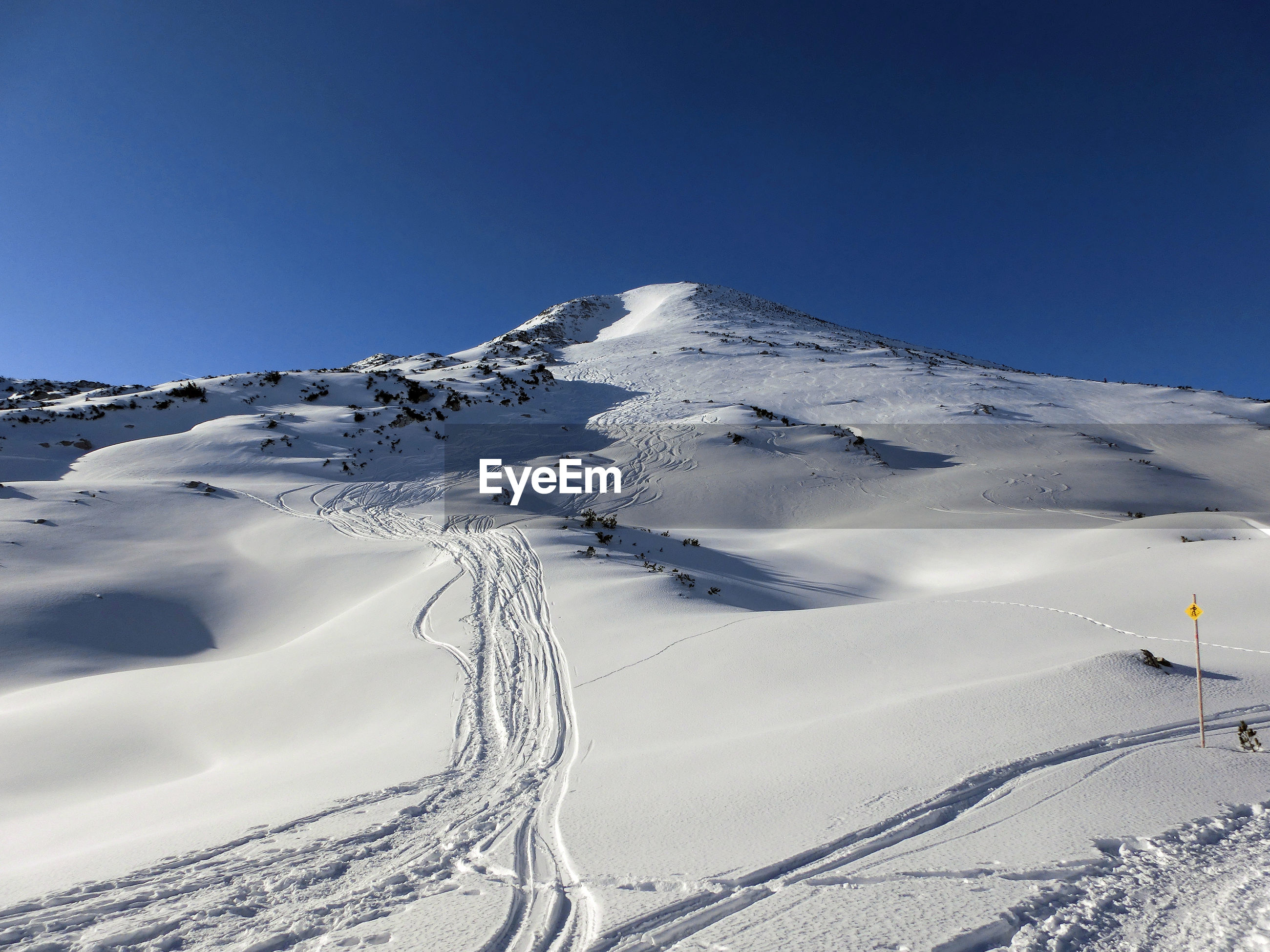 SNOW COVERED MOUNTAINS AGAINST CLEAR BLUE SKY