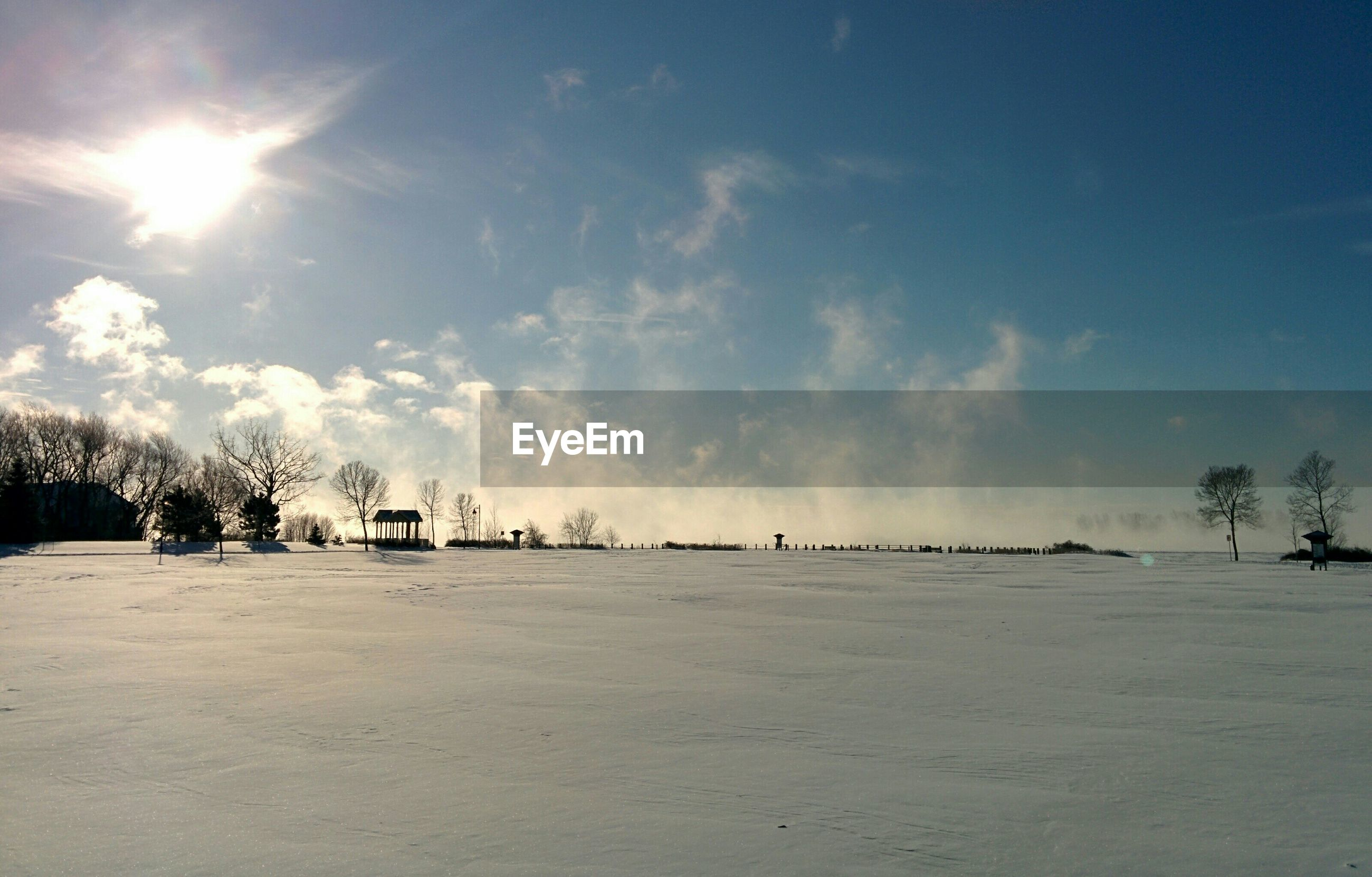 Snowcapped landscape against sky