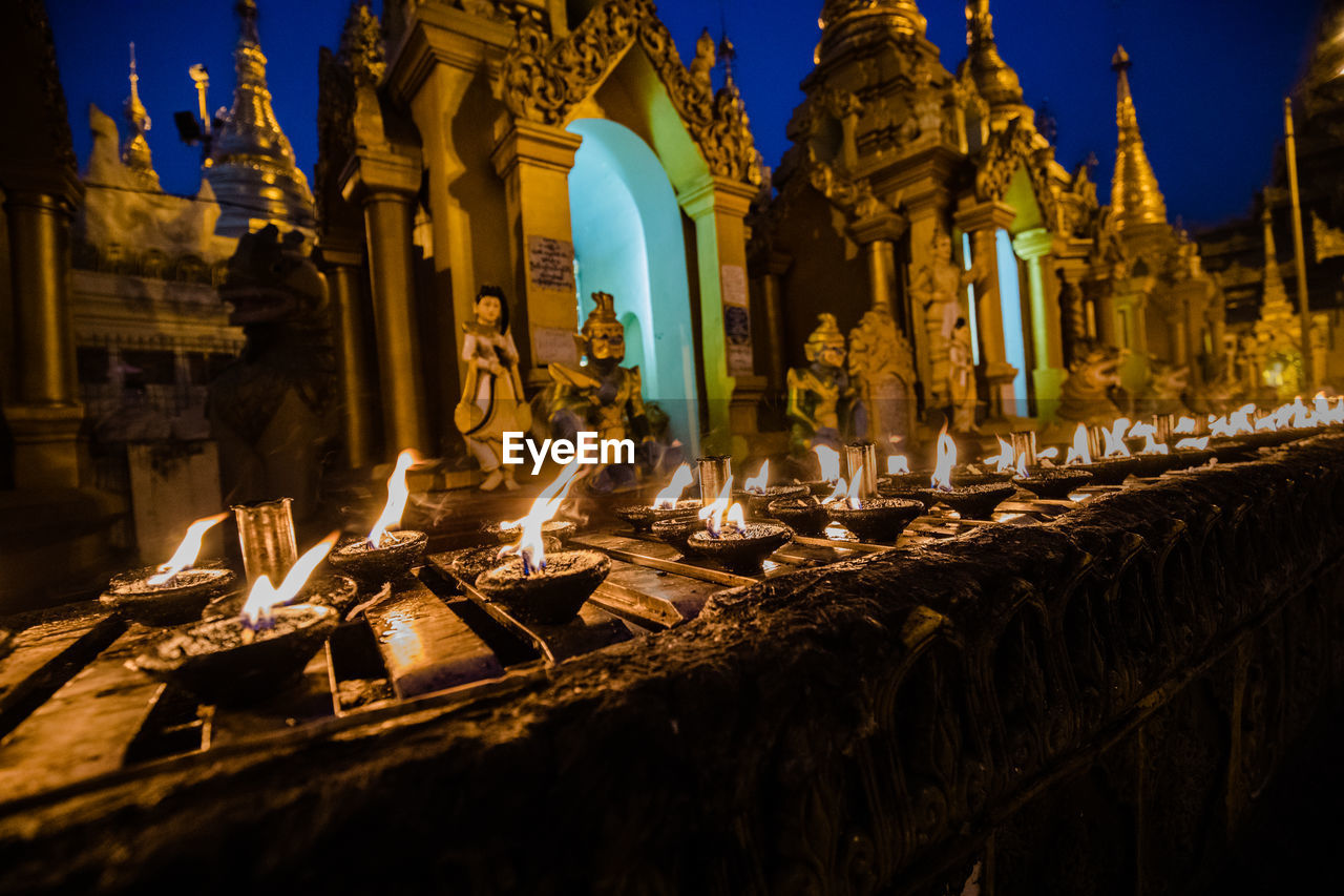 PANORAMIC VIEW OF ILLUMINATED TEMPLE BUILDING