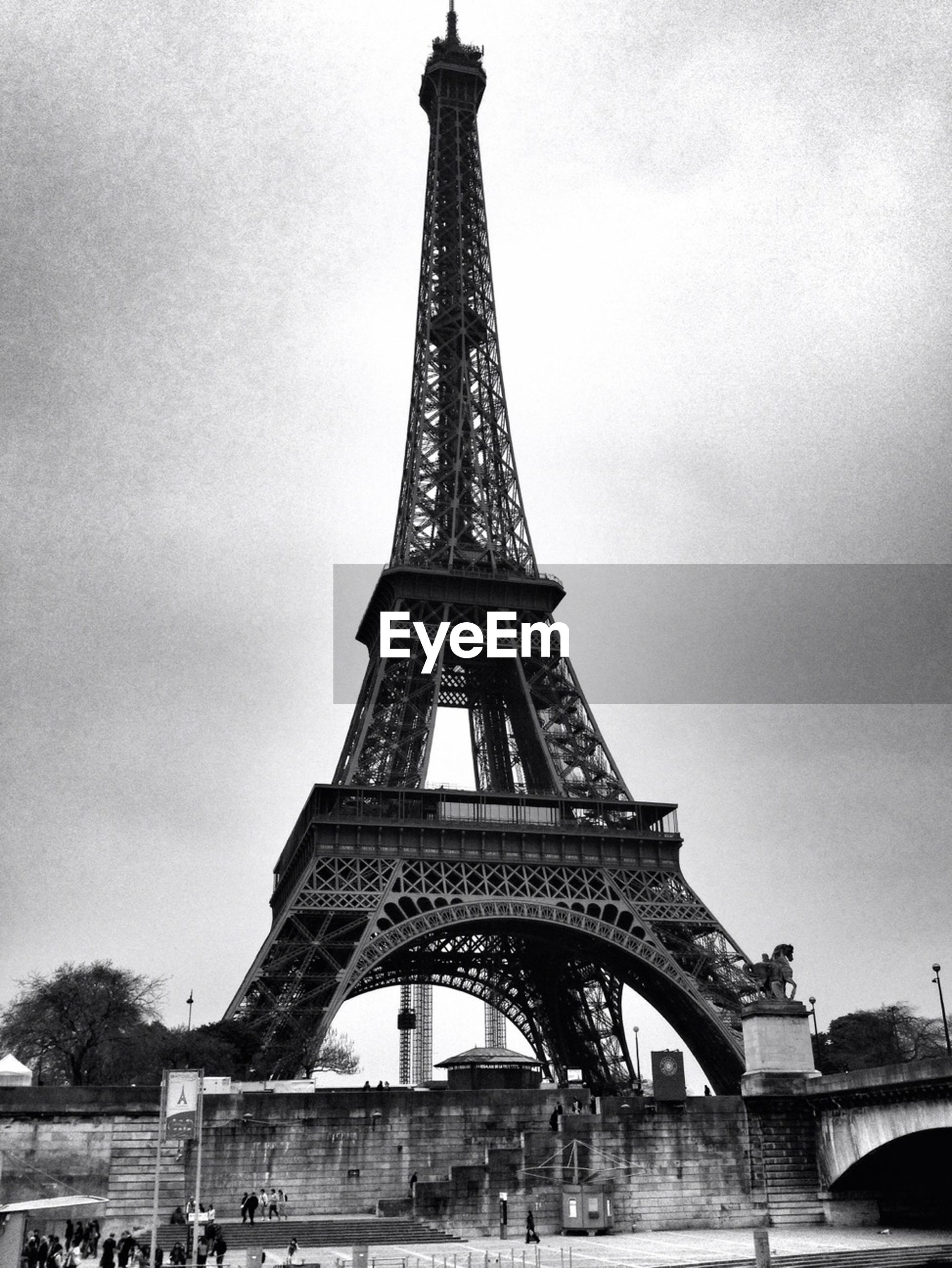 eiffel tower, architecture, built structure, international landmark, famous place, travel destinations, culture, tourism, tower, capital cities, travel, sky, history, metal, tall - high, low angle view, architectural feature, metallic, city, day