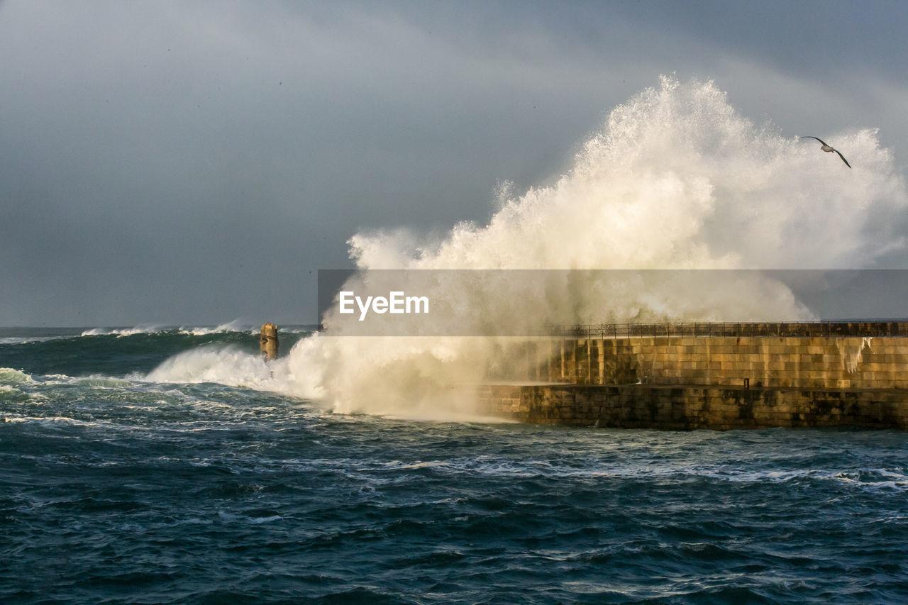 Waves Breaking Against Pier