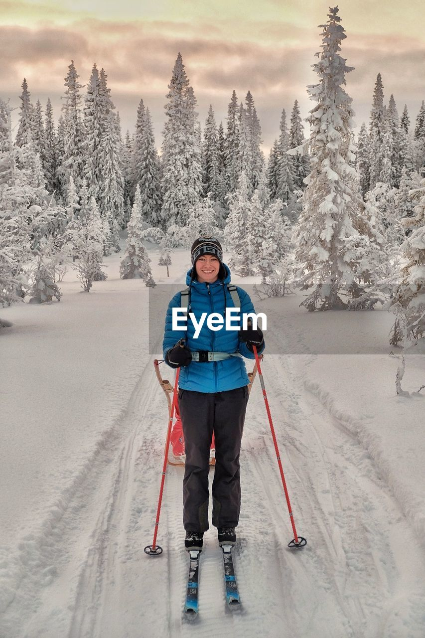 snow, cold temperature, winter, one person, full length, tree, real people, leisure activity, plant, nature, winter sport, lifestyles, land, warm clothing, field, front view, sport, clothing, outdoors