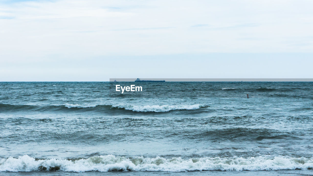 sea, horizon over water, sky, horizon, scenics - nature, water, beauty in nature, motion, wave, sport, aquatic sport, surfing, day, nature, land, waterfront, tranquil scene, beach, outdoors, power in nature