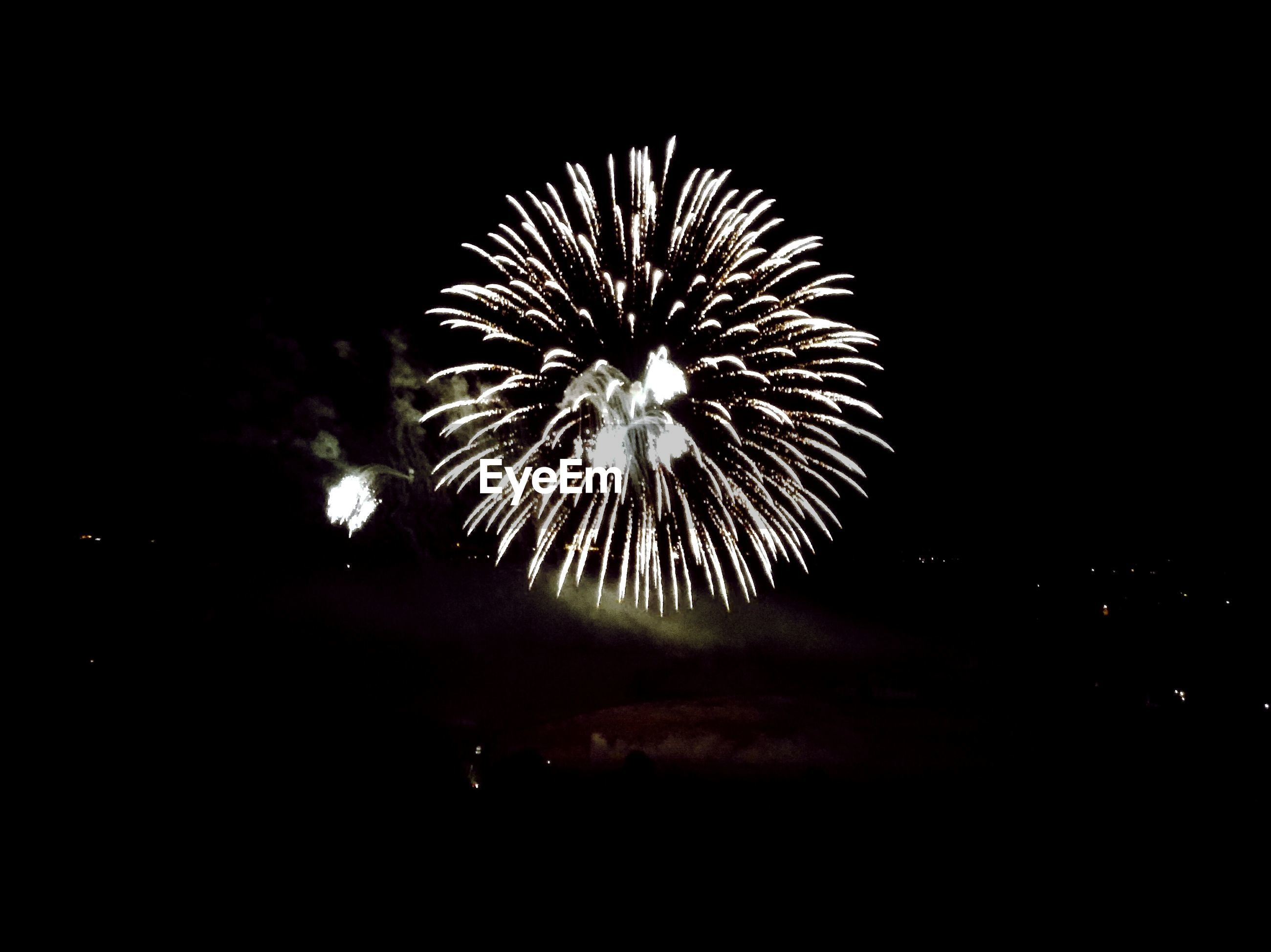 night, firework display, illuminated, exploding, long exposure, firework - man made object, glowing, motion, celebration, low angle view, sparks, sky, arts culture and entertainment, blurred motion, firework, event, entertainment, dark, outdoors, clear sky