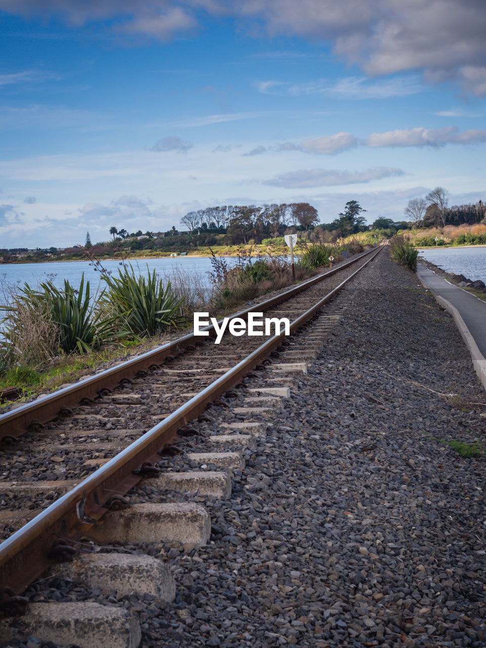 railroad track, rail transportation, the way forward, transportation, day, sky, no people, outdoors, nature, beauty in nature