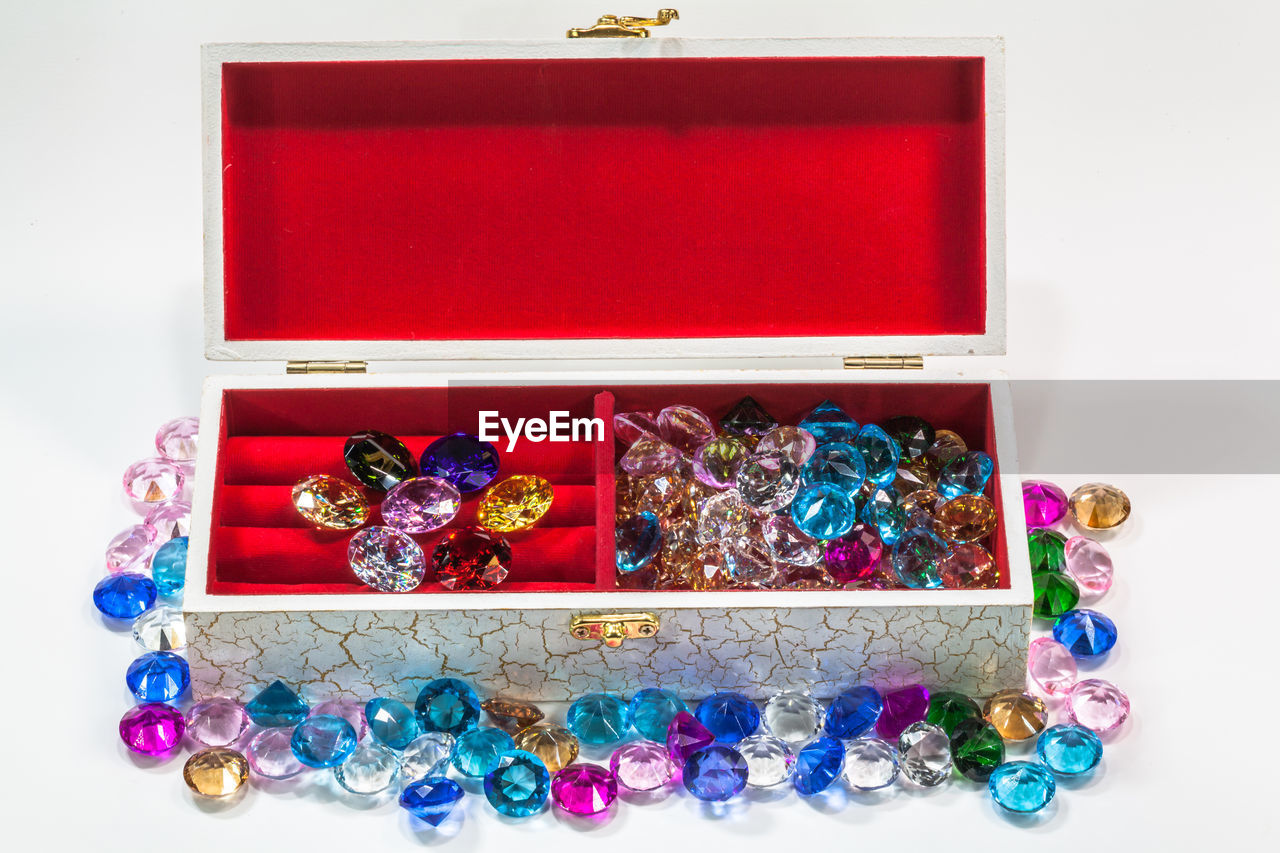 jewelry, wealth, jewelry box, large group of objects, box, indoors, precious gem, still life, no people, luxury, variation, choice, multi colored, studio shot, container, gemstone, abundance, diamond - gemstone, high angle view, art and craft, box - container, personal accessory