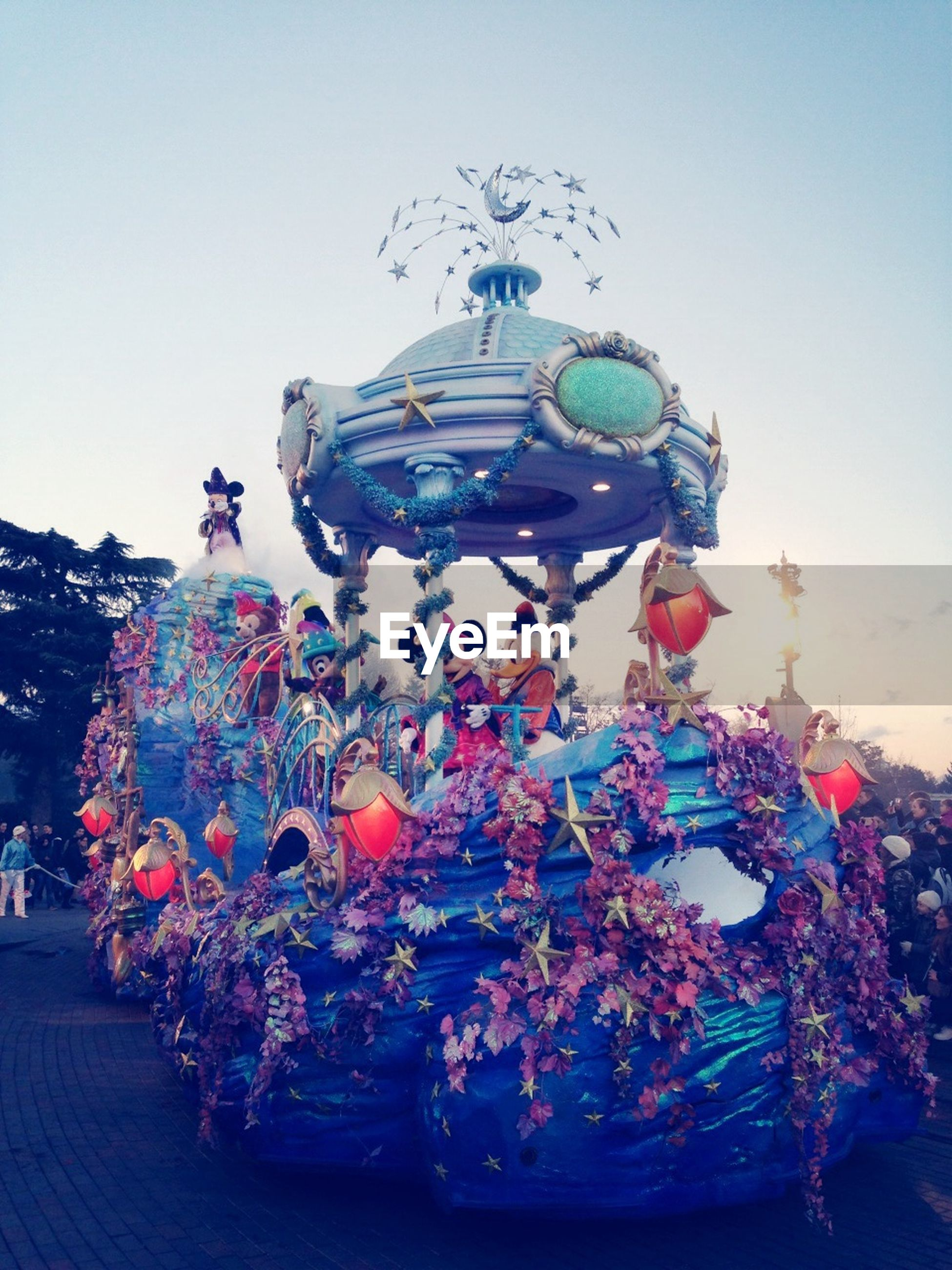 art and craft, low angle view, creativity, art, human representation, decoration, hanging, clear sky, lighting equipment, arts culture and entertainment, celebration, sculpture, wall - building feature, animal representation, no people, indoors, statue, amusement park