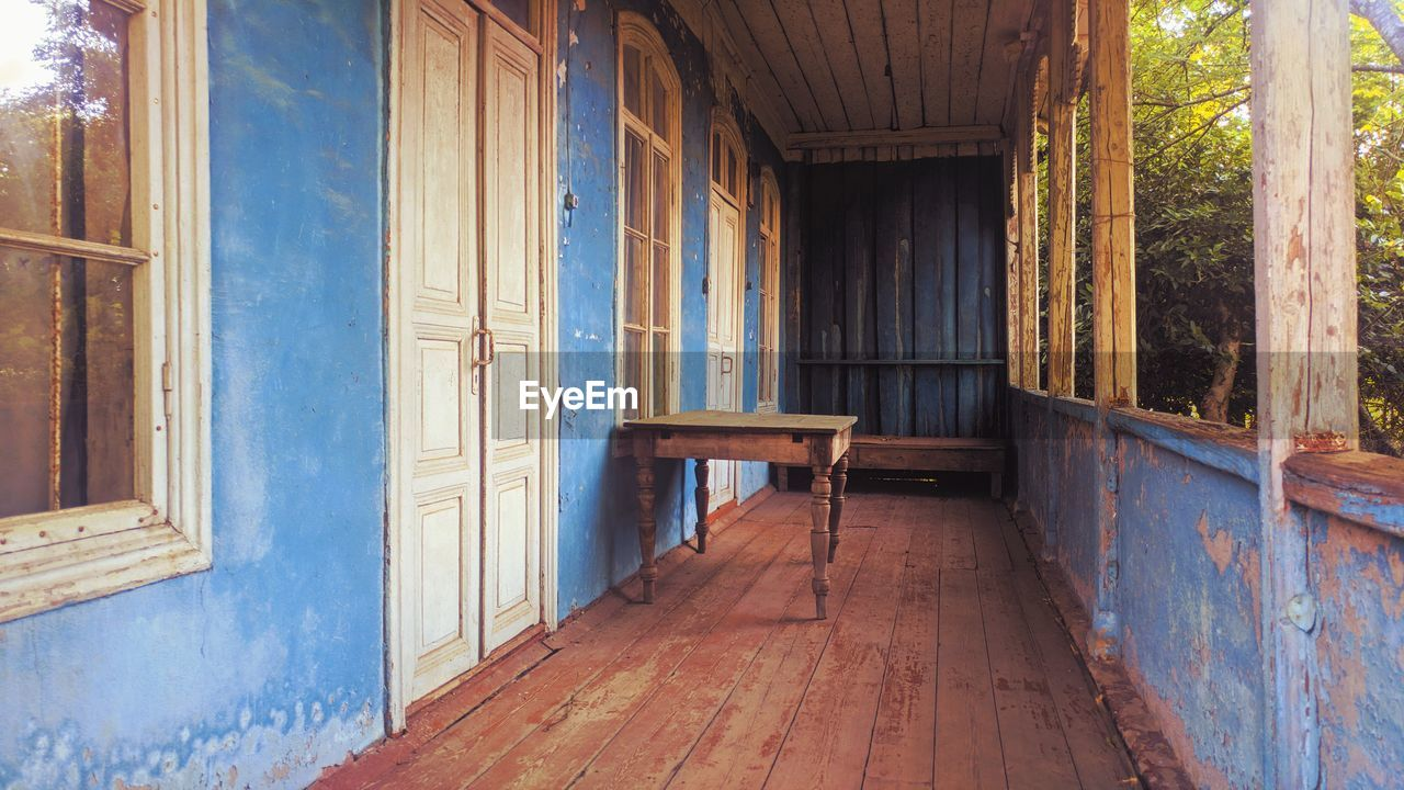 architecture, wood - material, built structure, building, house, day, entrance, door, building exterior, window, absence, flooring, wood, no people, home interior, empty, abandoned, seat