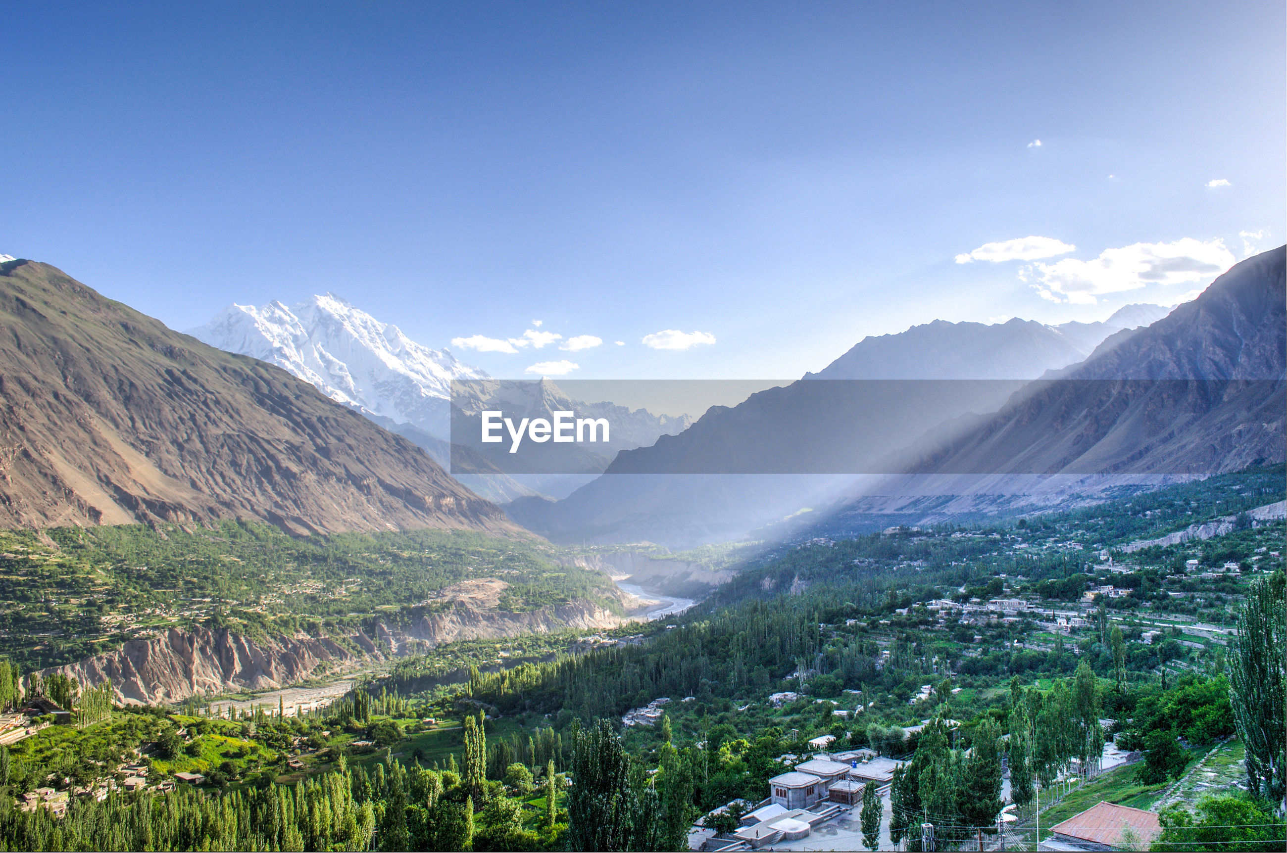 mountain, mountain range, scenics, tranquil scene, beauty in nature, tranquility, landscape, tree, nature, sky, blue, non-urban scene, snowcapped mountain, idyllic, valley, day, outdoors, no people, majestic, remote, growth, non urban scene, travel destinations, green color, cloud - sky, cloud