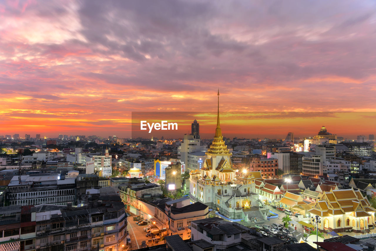 building exterior, architecture, built structure, city, sky, cloud - sky, sunset, cityscape, building, orange color, travel destinations, crowded, nature, high angle view, place of worship, crowd, religion, illuminated, outdoors, spire