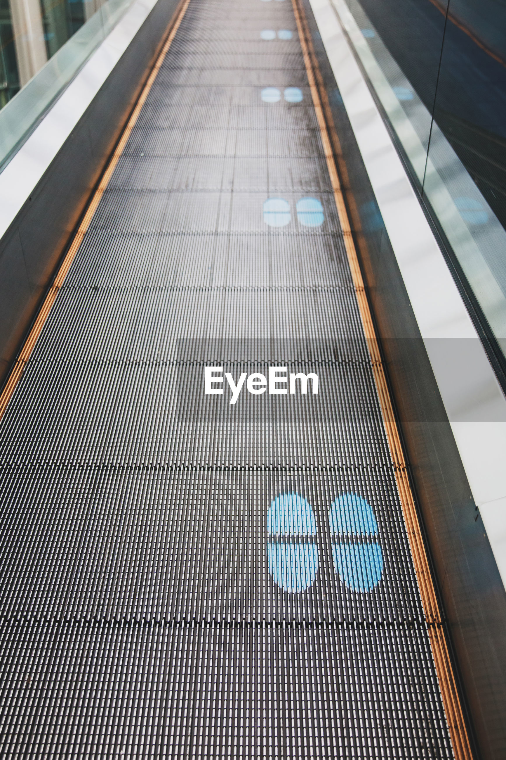 Footprints printed on the escalator for social distancing
