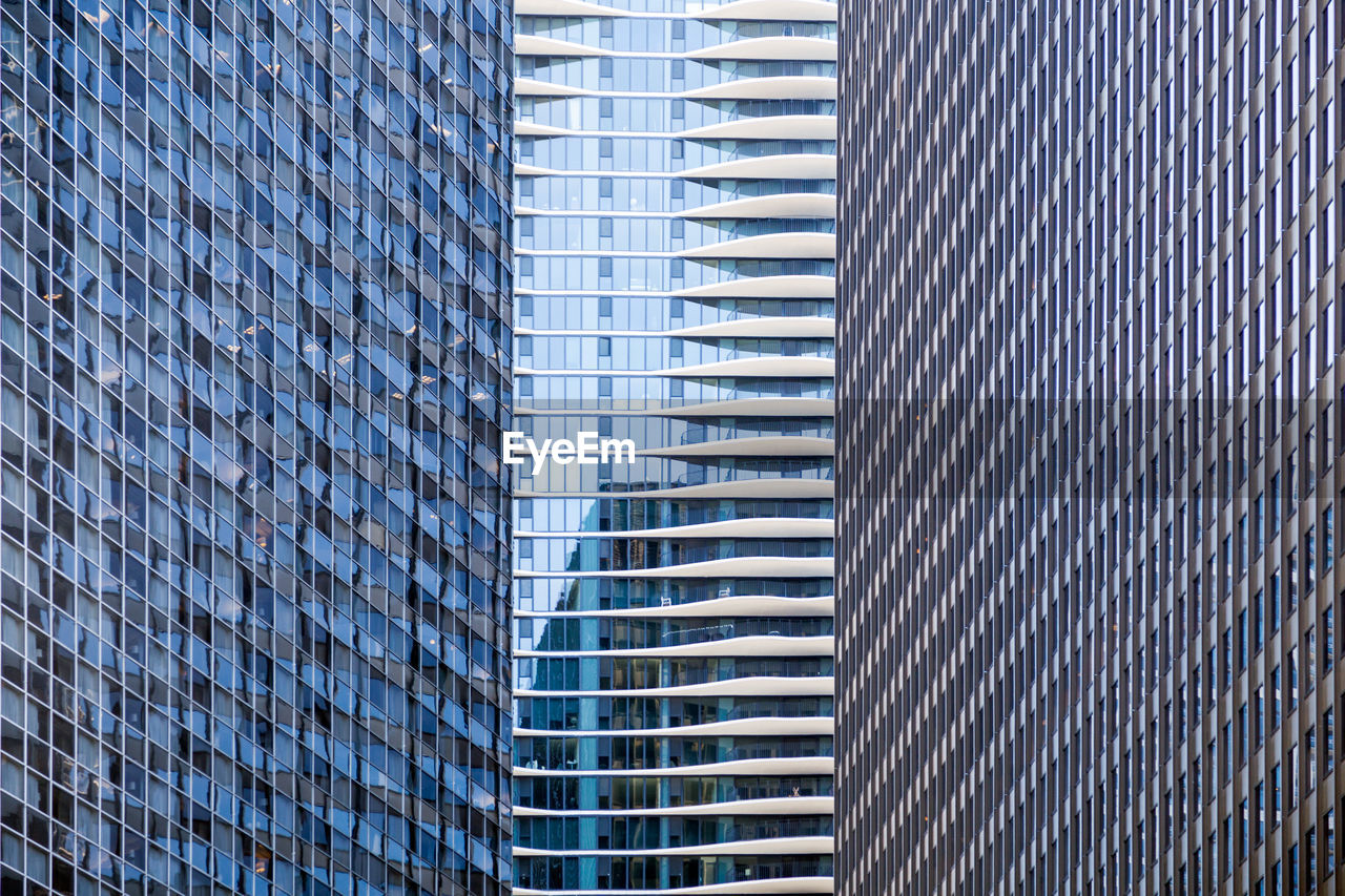 architecture, built structure, building exterior, modern, office building exterior, city, building, office, full frame, low angle view, day, no people, backgrounds, tall - high, skyscraper, window, pattern, glass - material, outdoors, reflection
