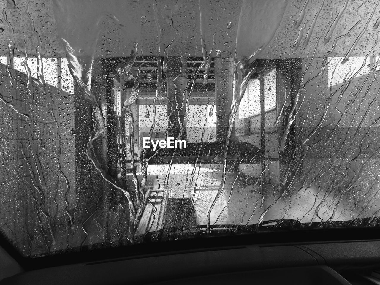 window, transparent, glass - material, car, windshield, land vehicle, transportation, mode of transport, car interior, looking through window, day, no people, indoors, water, car wash, close-up