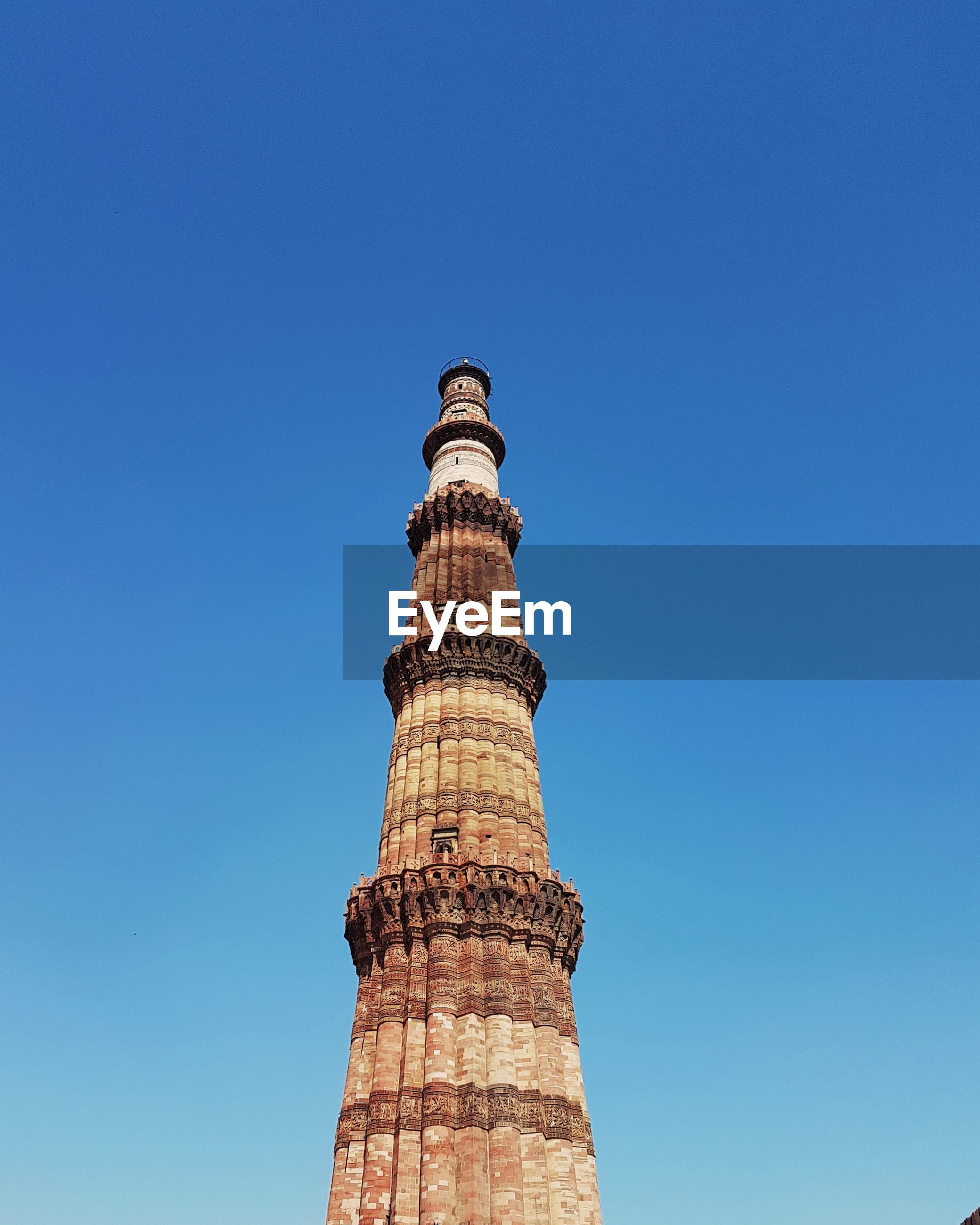 low angle view, blue, sky, clear sky, outdoors, no people, built structure, cultures, architecture, day, close-up