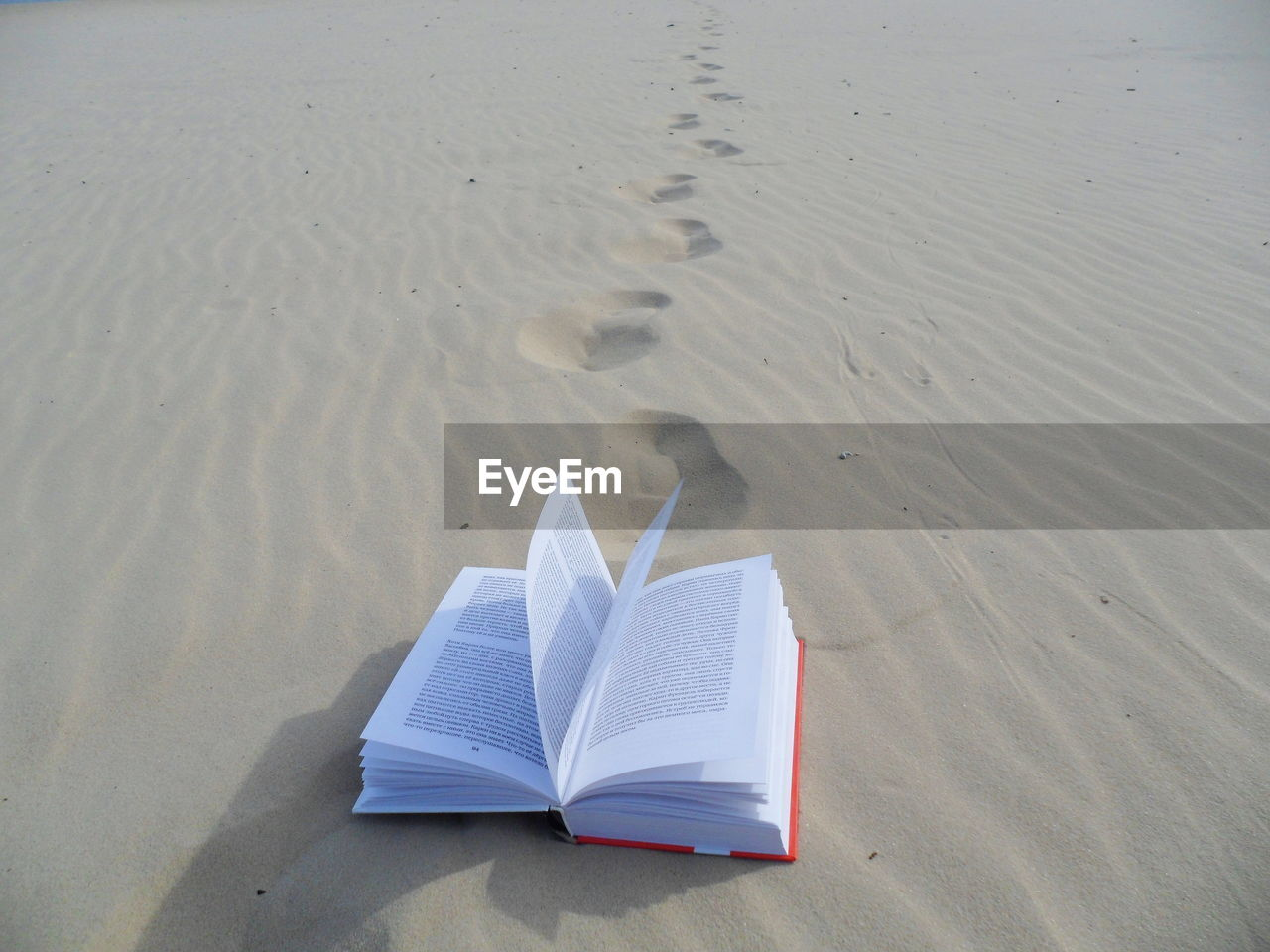 sand, beach, land, book, publication, paper, high angle view, no people, nature, open, tranquility, day, water, absence, sunlight, outdoors, shadow, beauty in nature, reading
