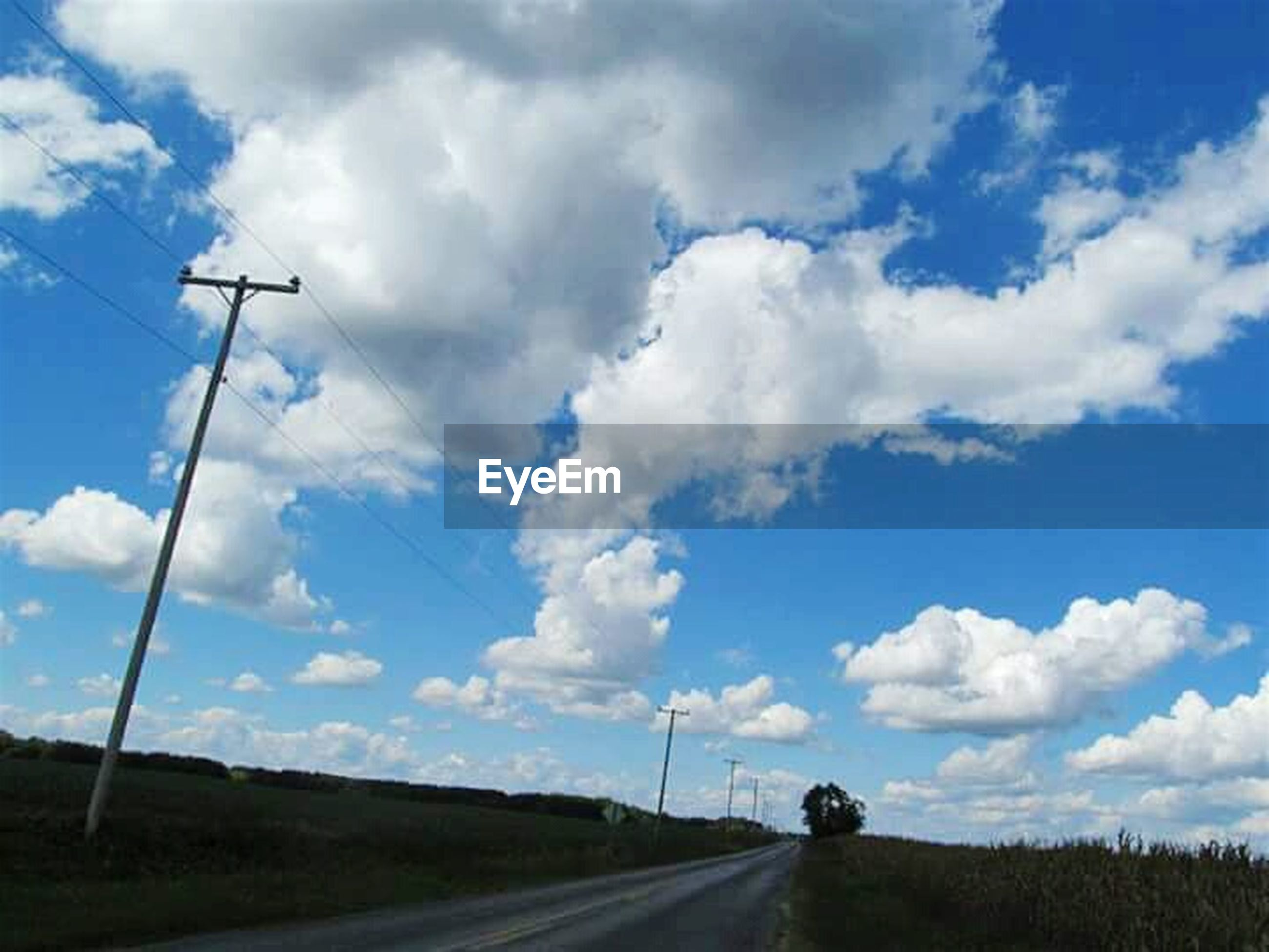cloud - sky, sky, road, transportation, alternative energy, cable, wind turbine, rural scene, outdoors, wind power, blue, day, telephone line, fuel and power generation, landscape, nature, no people, scenics, technology, road sign