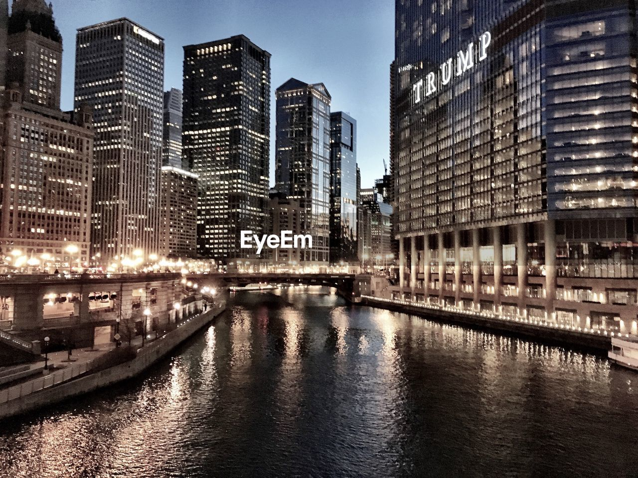 architecture, building exterior, built structure, city, skyscraper, travel destinations, waterfront, transportation, modern, illuminated, city life, outdoors, sky, no people, water, cityscape, urban skyline, day, nautical vessel