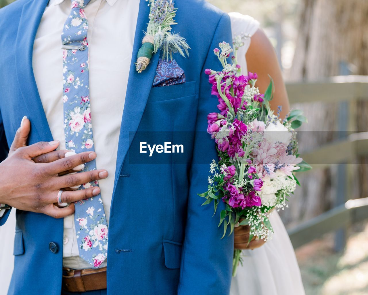 flower, midsection, flowering plant, women, adult, wedding, event, love, real people, life events, bride, standing, celebration, newlywed, well-dressed, day, two people, married, couple - relationship, lifestyles, positive emotion, flower arrangement, bouquet, wedding ceremony