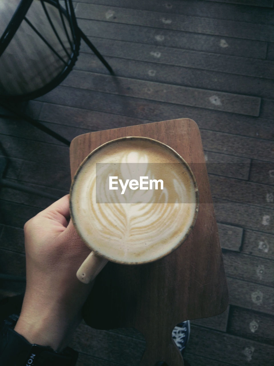 Waitress Serving Cappuccino On Cafe Tray