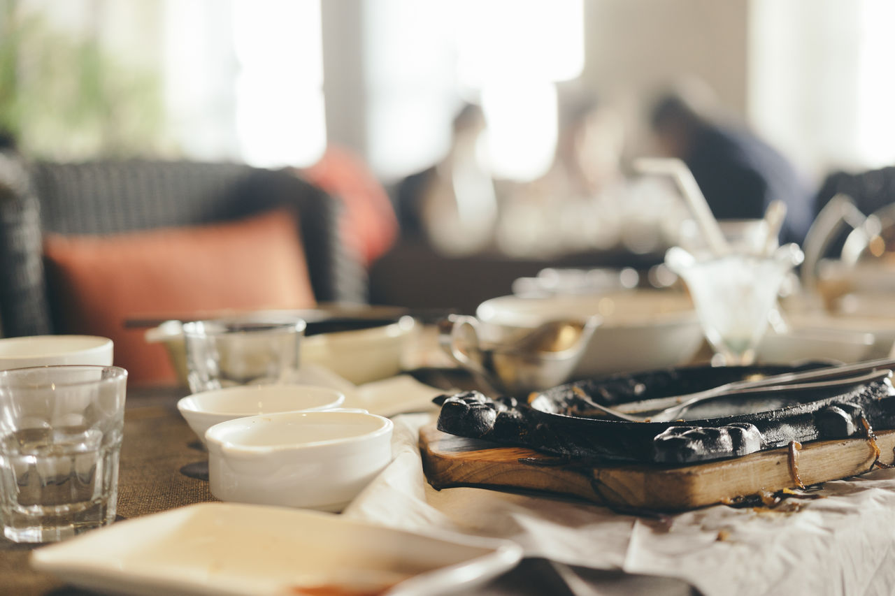 Close-Up Of Messy Utensils On Table