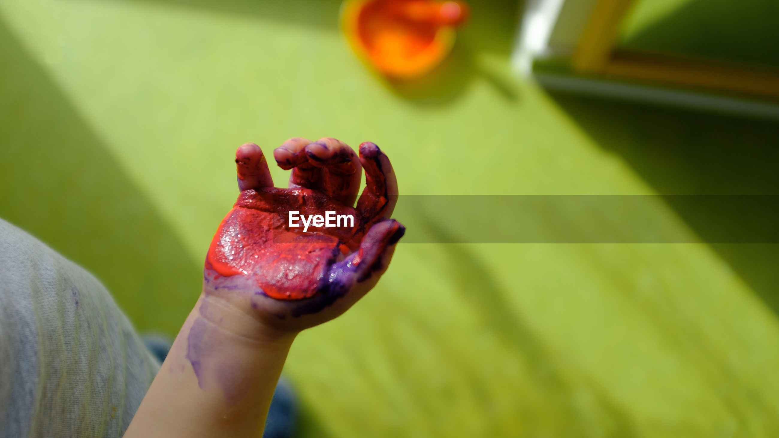 Midsection of boy with paint on hand