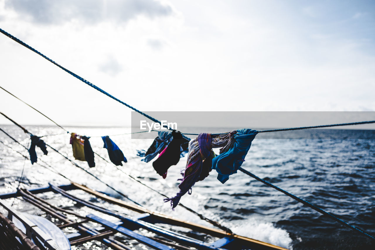 Clothes drying of rope at boat on sea