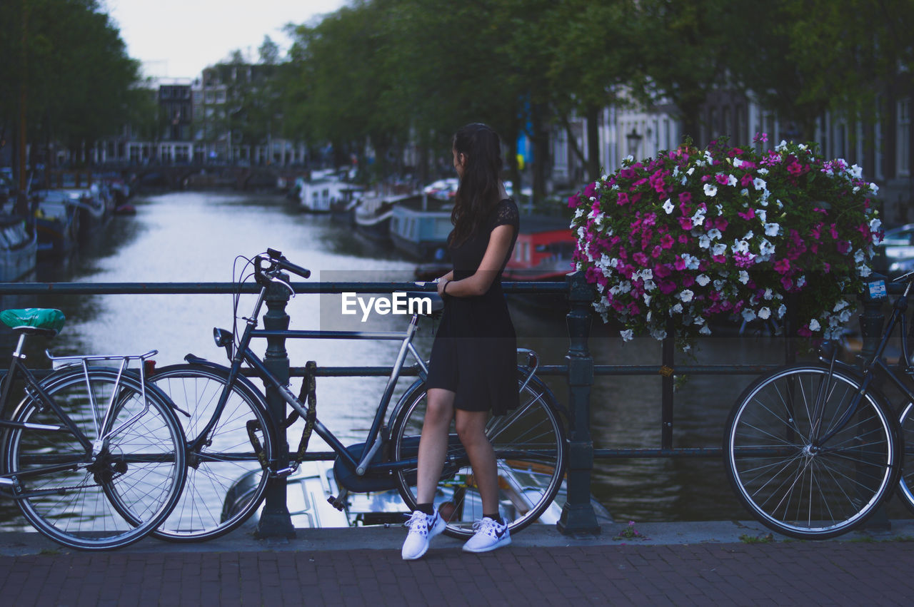 Bicycle Cycling Transportation Mode Of Transport Water Full Length Lake Outdoors Adult Day People Land Vehicle Social Issues One Person City Standing Lifestyles One Woman Only Adults Only Women Amsterdam GetbetterwithAlex Brandon Woelfel Interrail Landscape The Week On EyeEm EyeEmNewHere Been There. Done That. Lost In The Landscape Connected By Travel Perspectives On Nature Rethink Things Postcode Postcards Second Acts